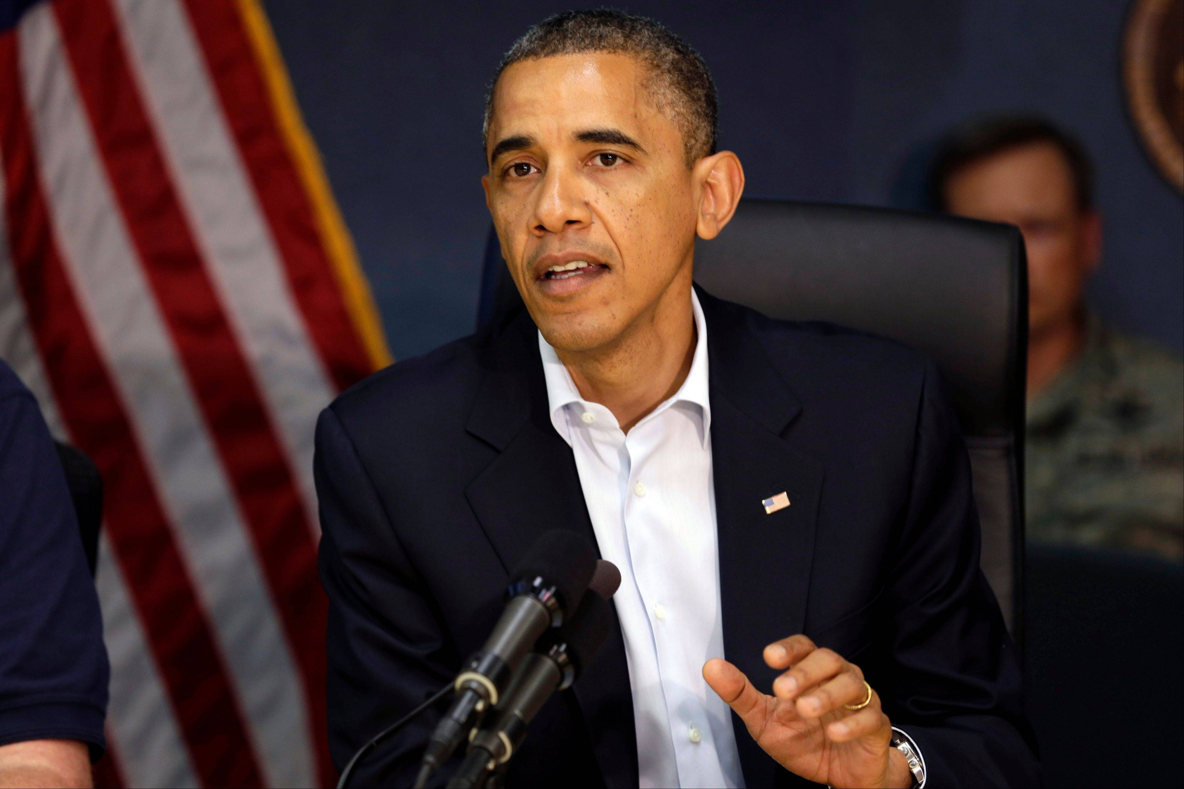 President Barack Obama speaks at Federal Emergency Management Agency headquarters in Washington Sunday.