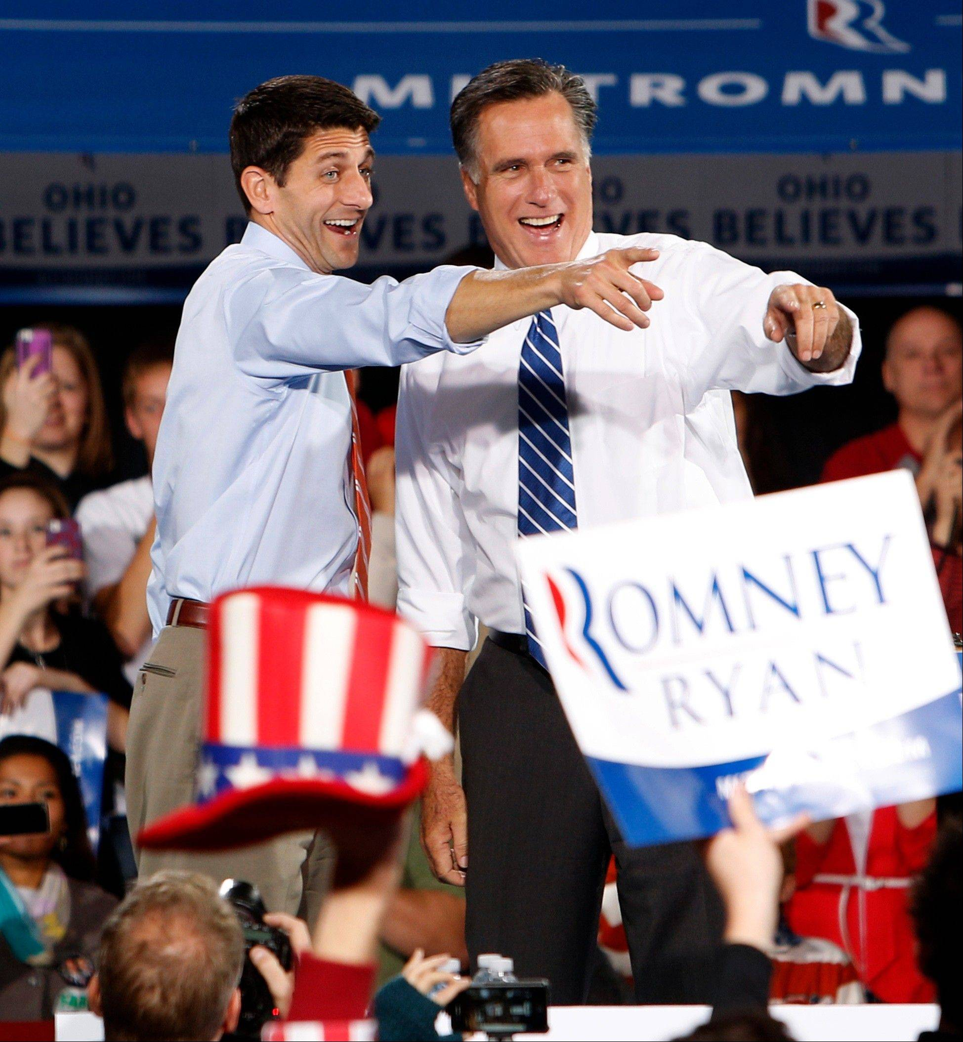 GOP presidential candidate Mitt Romney, right, and his vice presidential running mate, Rep. Paul Ryan, campaign in Celina, Ohio, Sunday.