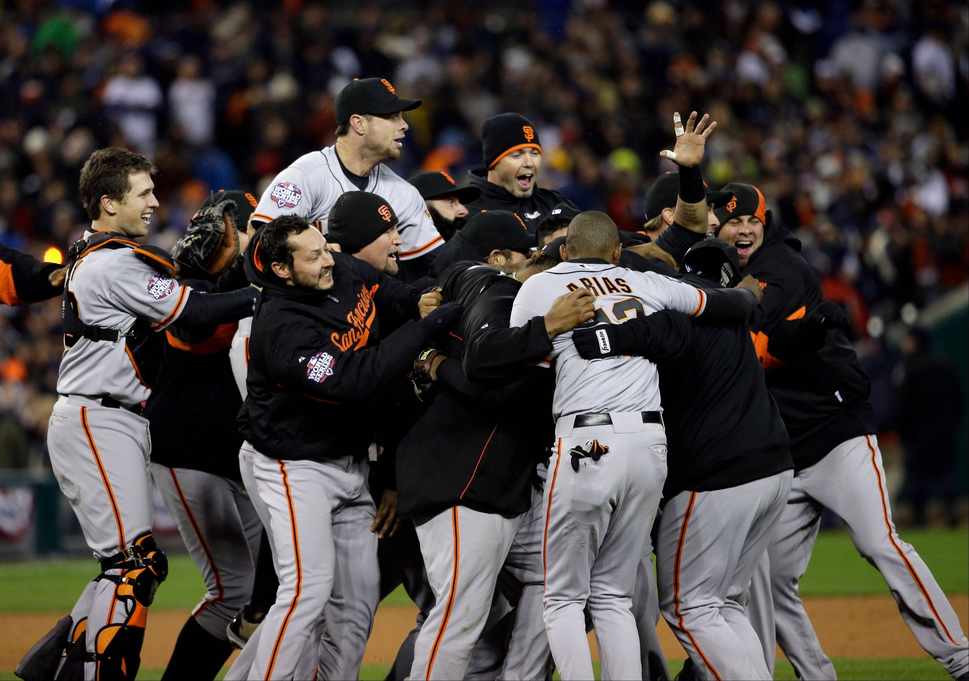 The San Francisco Giants celebrate after winning Game 4 of baseball's World Series against the Detroit Tigers Sunday, Oct. 28, 2012, in Detroit. The Giants won 4-3 to win the series.