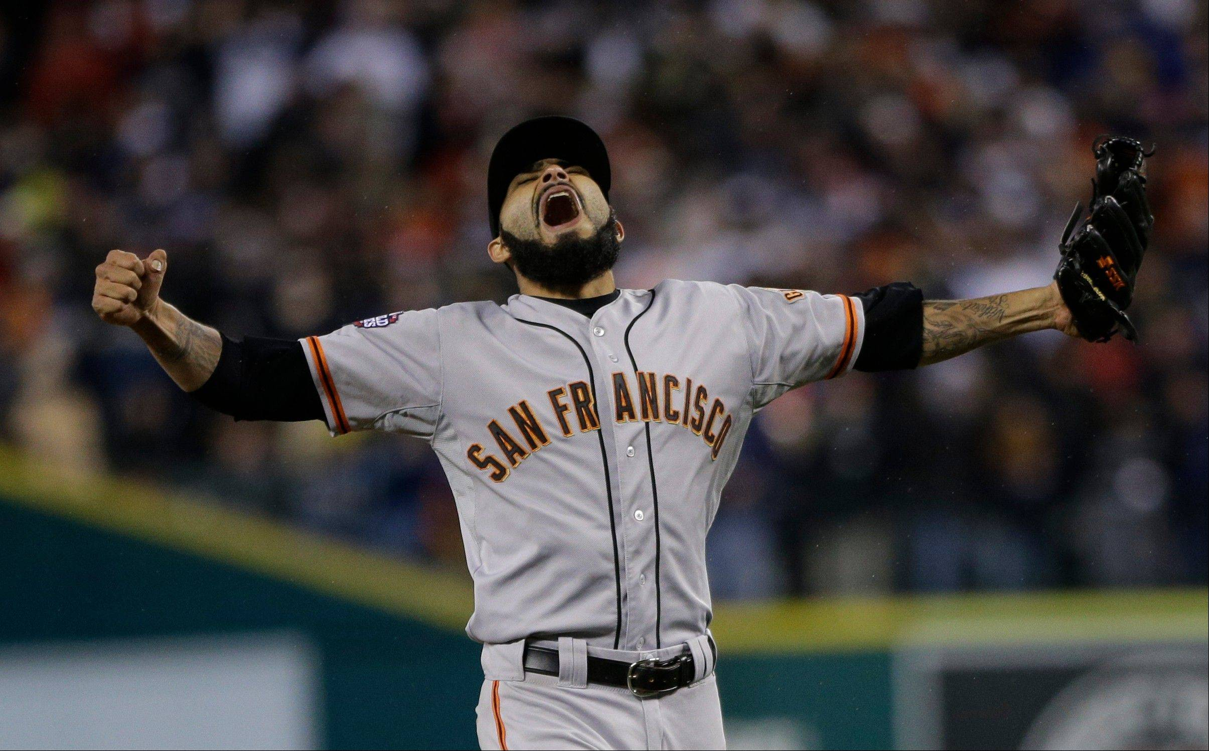 San Francisco Giants pitcher Sergio Romo reacts after striking out Detroit Tigers' Miguel Cabrera in the 10th inning of Game 4 of baseball's World Series Sunday, Oct. 28, 2012, in Detroit. The Giants won the game 4-3 to win the World Series.
