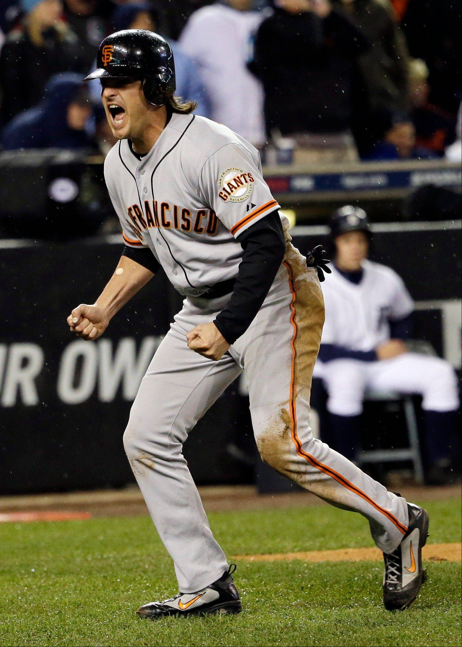San Francisco Giants infielder Ryan Theriot reacts after scoring from second on a hit by Marco Scutaro during the 10th inning of Game 4 of baseball's World Series against the Detroit Tigers Sunday, Oct. 28, 2012, in Detroit. Theriot, a former Cub, also won the World Series in 2011 as a member of the St. Louis Cardinals.