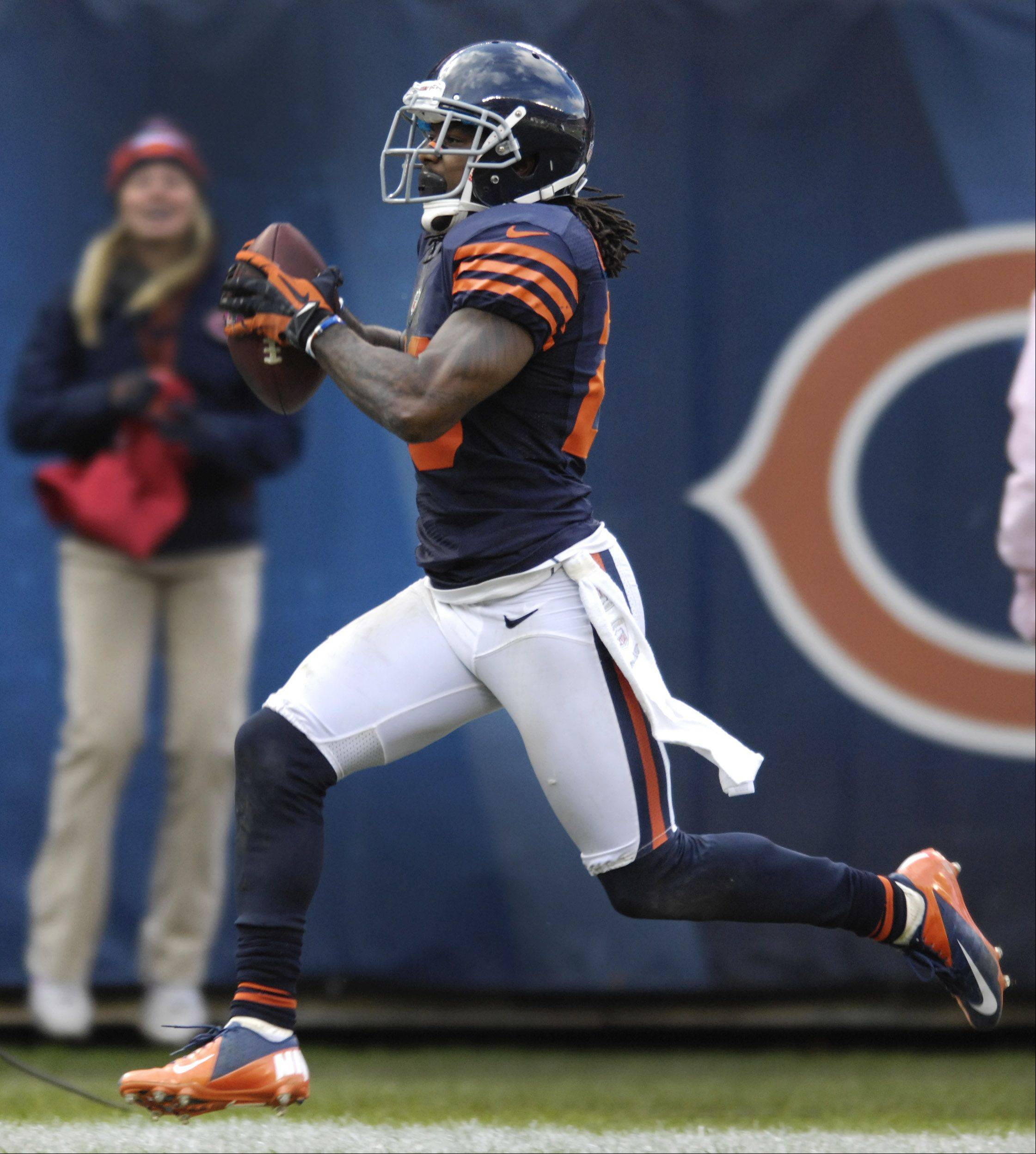 Chicago Bears cornerback Tim Jennings runs an interception for a touchdown during Sunday's game against the Carolina Panthers at Soldier Field.