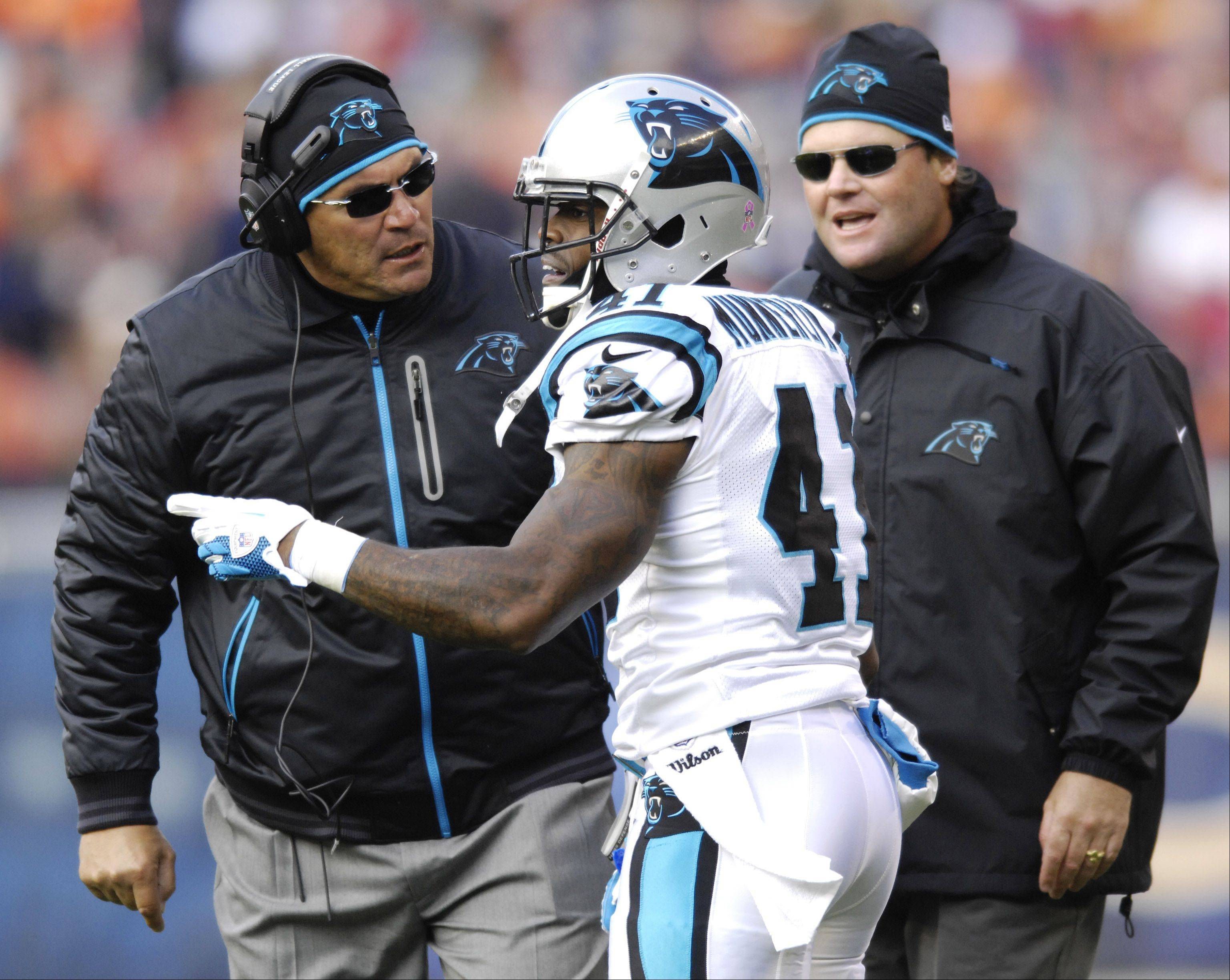 Carolina Panthers head coach Ron Rivera, left, talks with Carolina Panthers cornerback Captain Munnerlyn during Sunday's game against the Bears at Soldier Field.