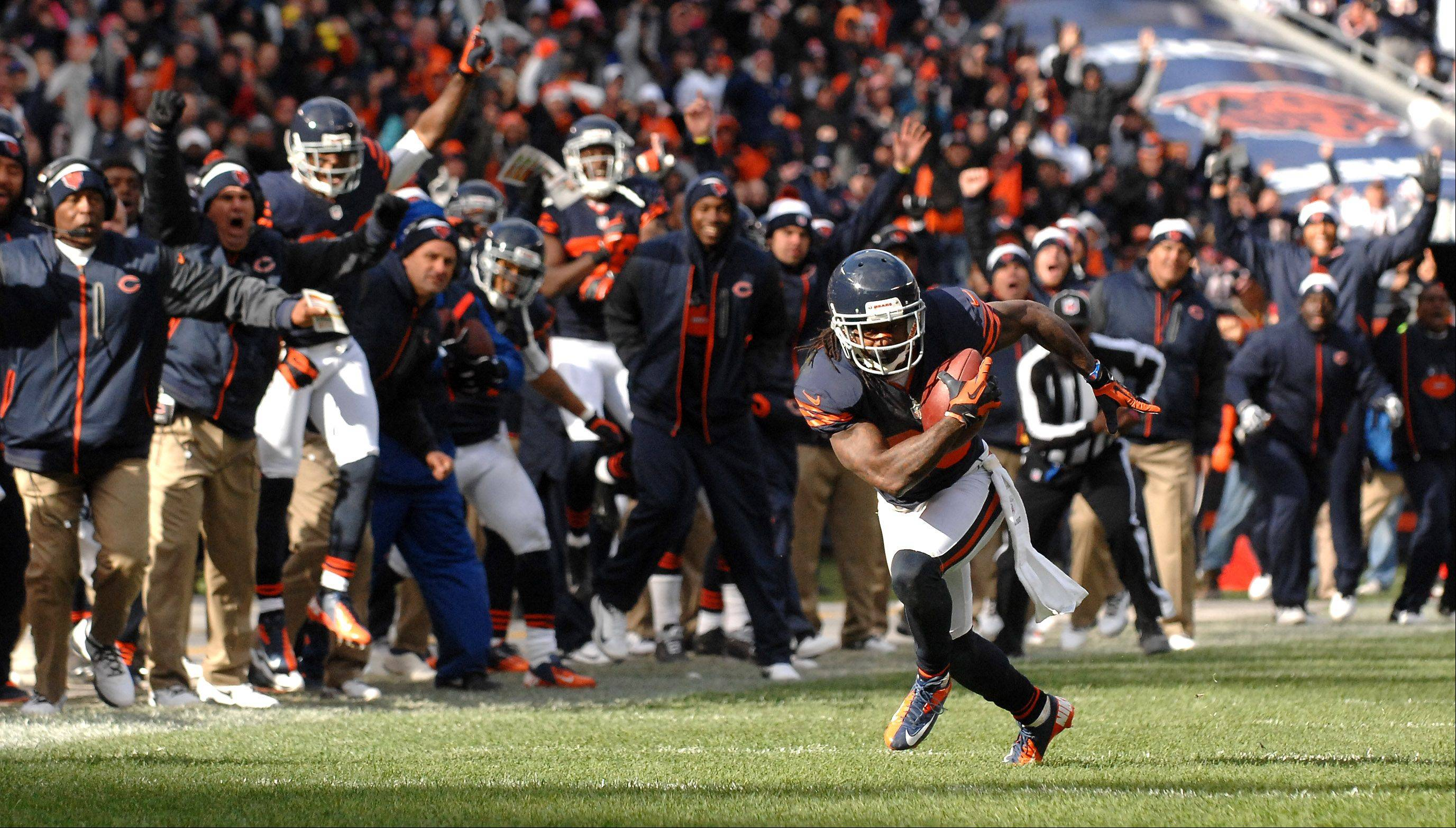 The Chicago Bears bench erupts as cornerback Tim Jennings (26) returns an interception for a touchdown during Sunday's game at Soldier Field in Chicago.