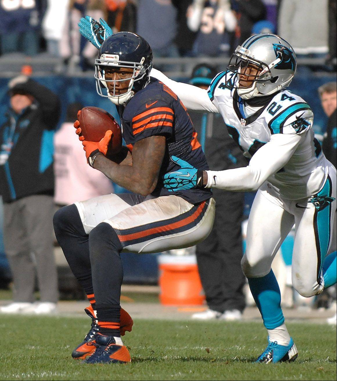 Chicago Bears wide receiver Brandon Marshall (15) makes a catch on the game-winning drive as Carolina Panthers defensive back Josh Norman (24) defends during Sunday's game at Soldier Field in Chicago.