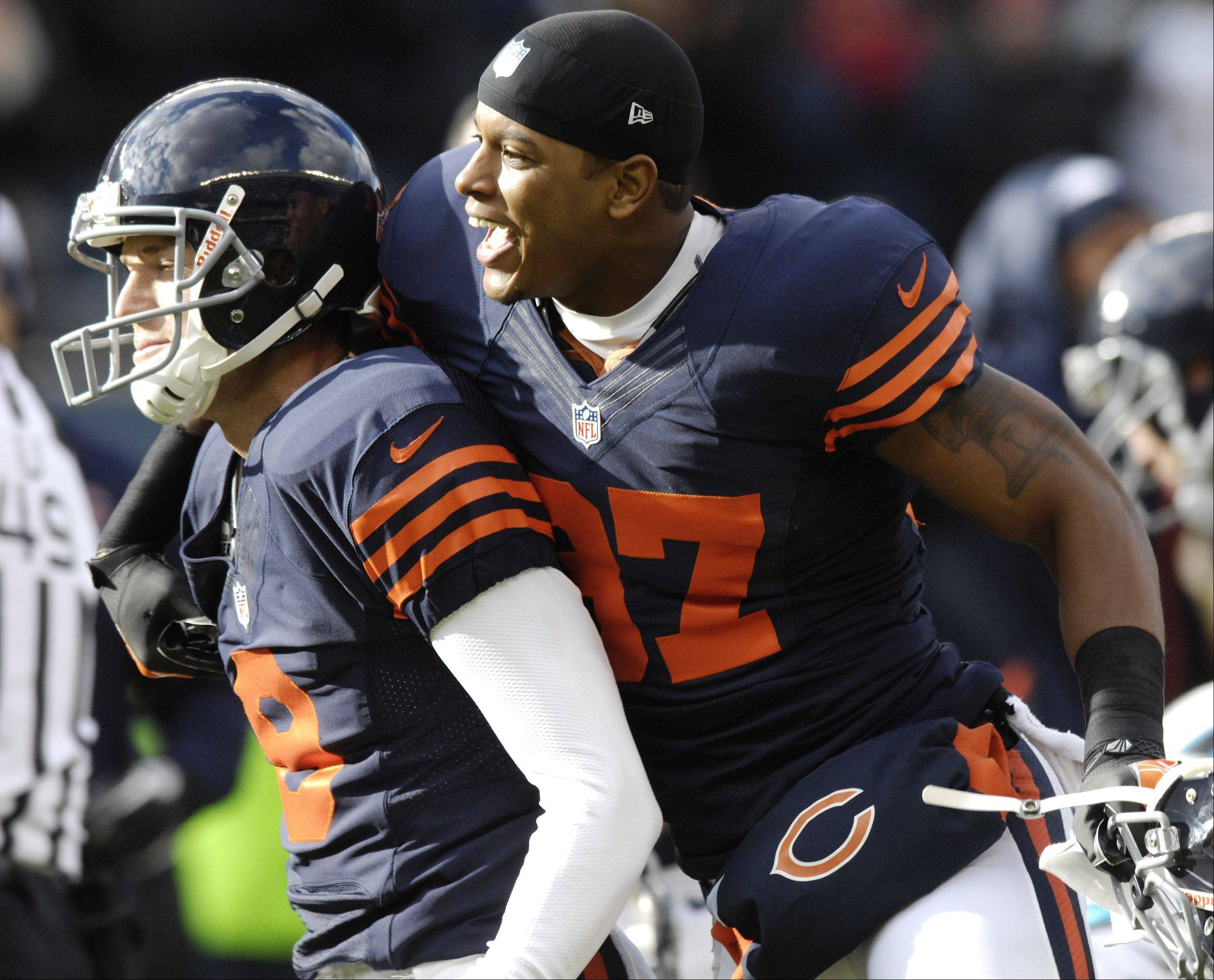 Chicago Bears free safety Anthony Walters, right, celebrates Chicago Bears kicker Robbie Gould's game-winning field goal during Sunday's game at Soldier Field.