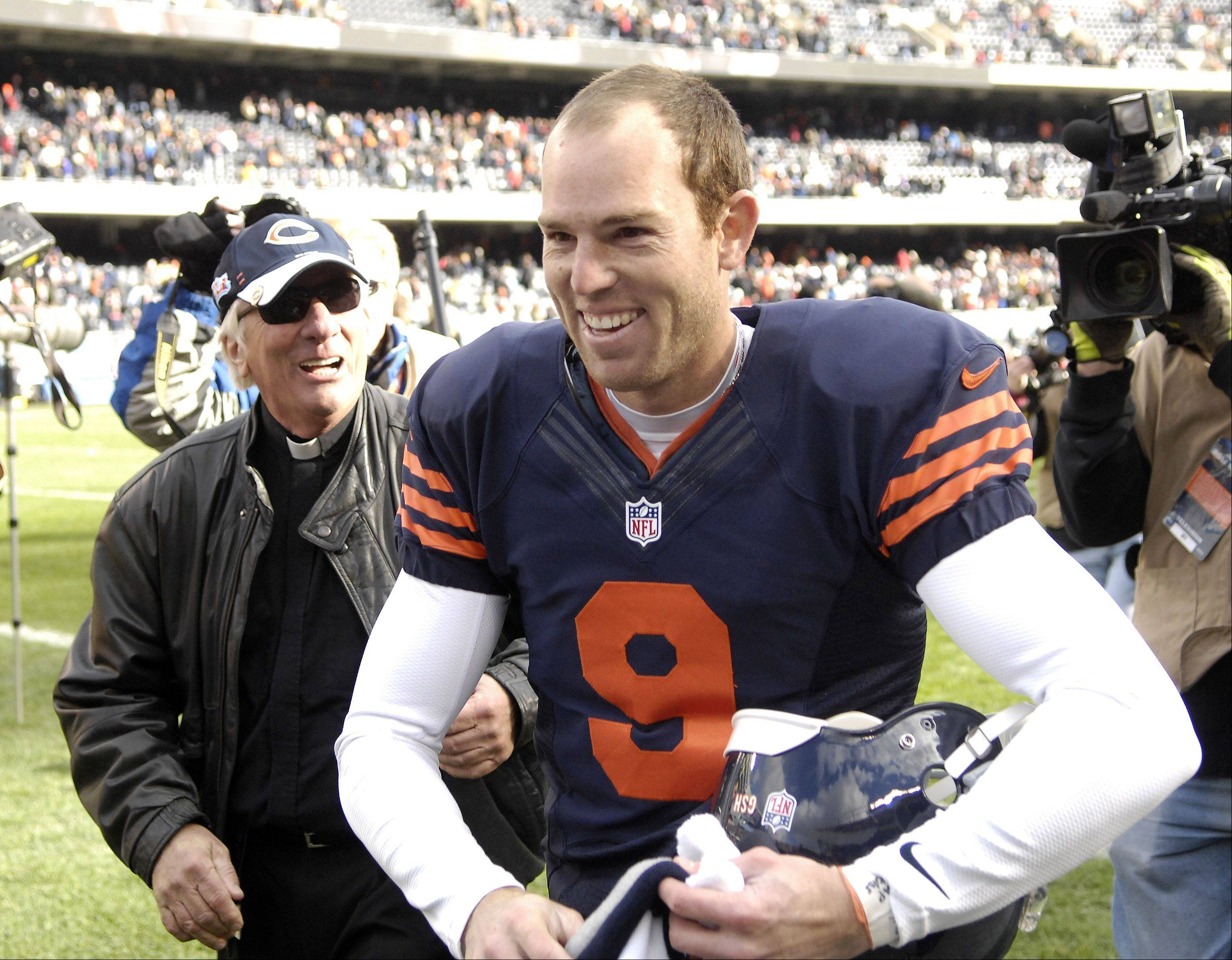 Chicago Bears kicker Robbie Gould (9) is all smiles as he leaves the field after his game-winning field goal during Sunday's game at Soldier Field in Chicago.