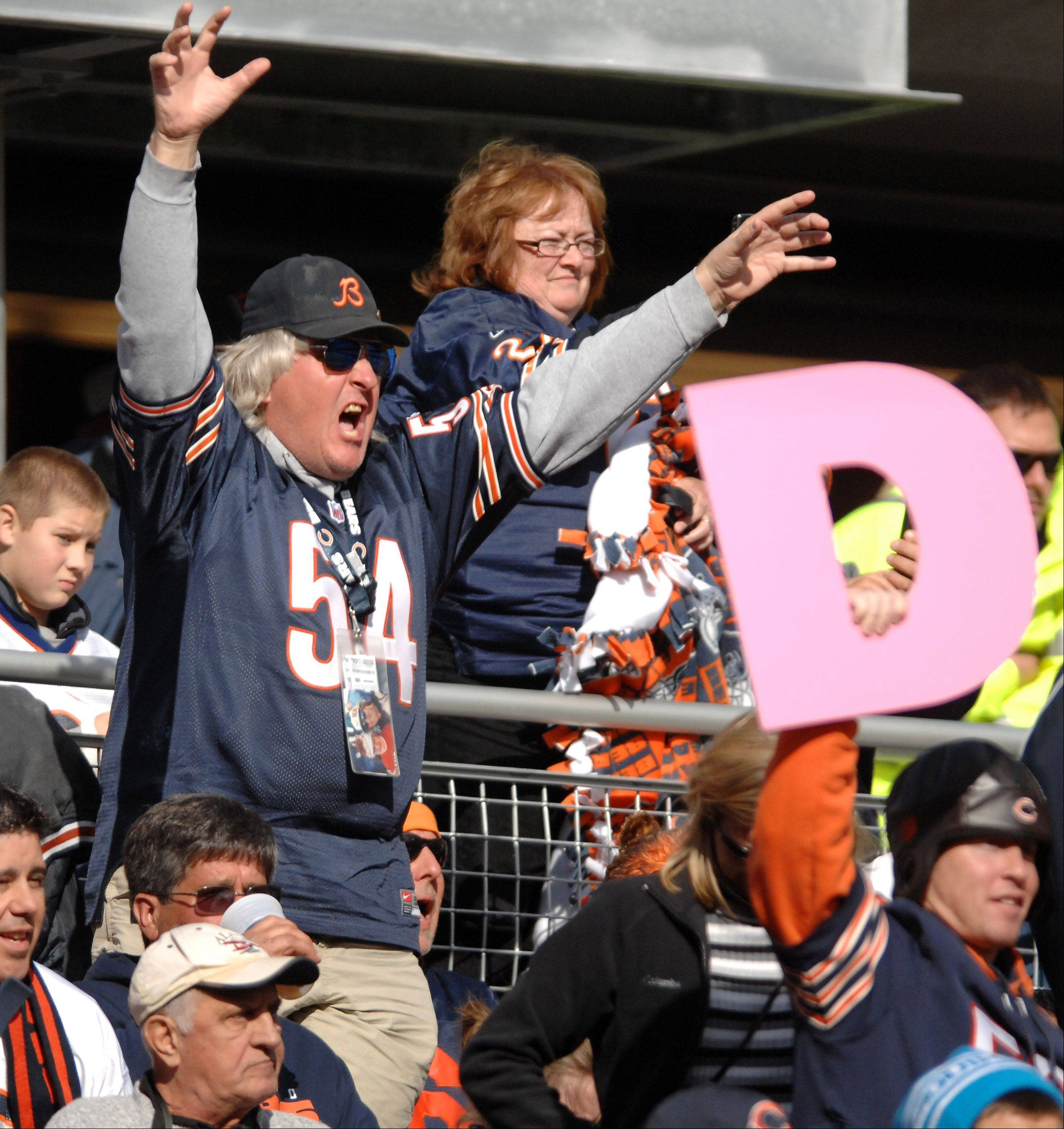 Bears fans urge on the defense during Sunday's game at Soldier Field in Chicago.