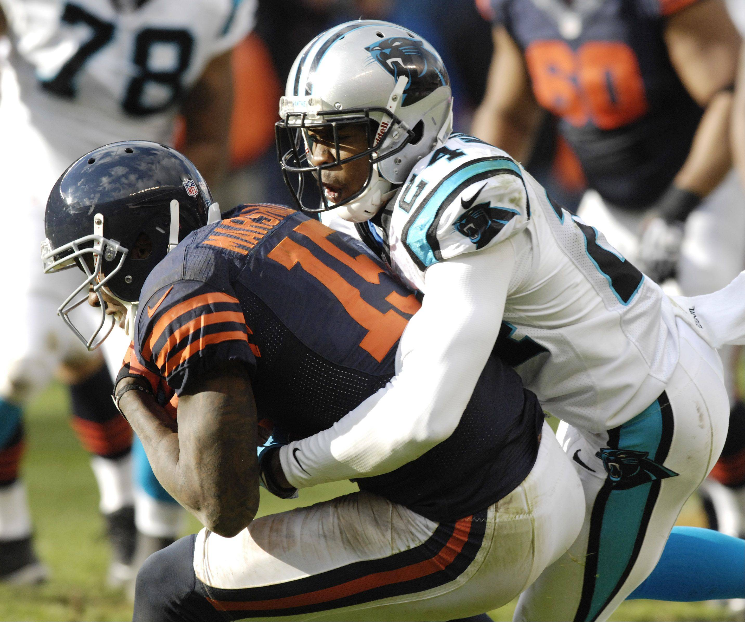 Chicago Bears wide receiver Brandon Marshall gets tackled by Carolina Panthers defensive back Josh Norman on the final drive during Sunday's game at Soldier Field.