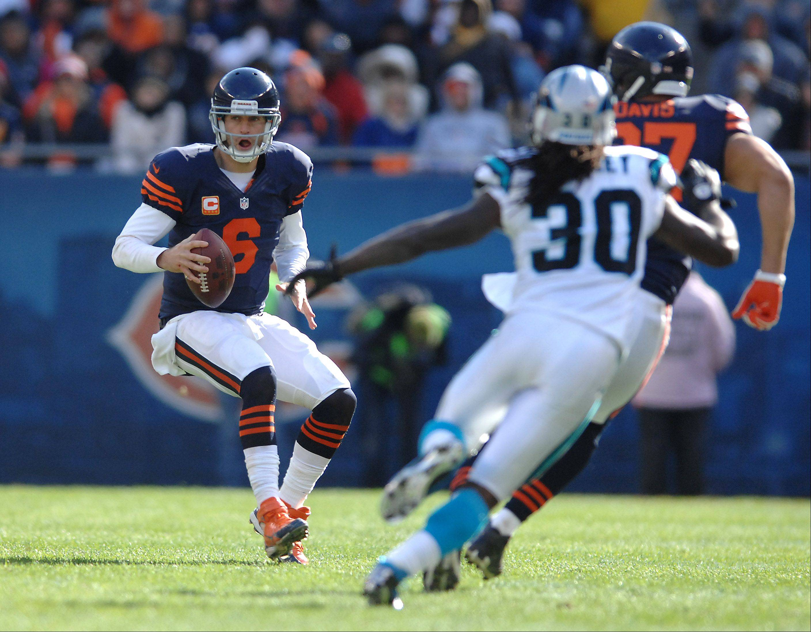 Chicago Bears quarterback Jay Cutler (6) scrambles for a short gain against Carolina during Sunday's game at Soldier Field in Chicago.