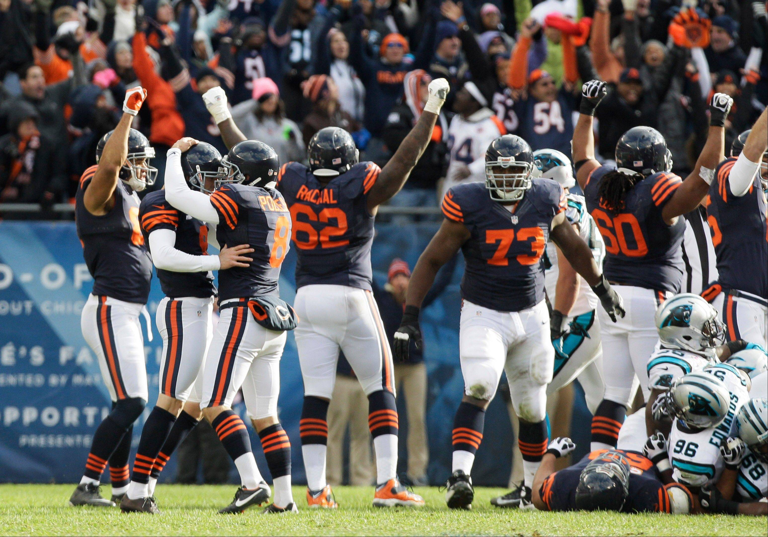 Chicago Bears kicker Robbie Gould (9), second from left, is congratulated by holder Adam Podlesh (8) after Gould kicked a game-winning, 41-yard field goal in the closing seconds to beat the Carolina Panthers 23-22.