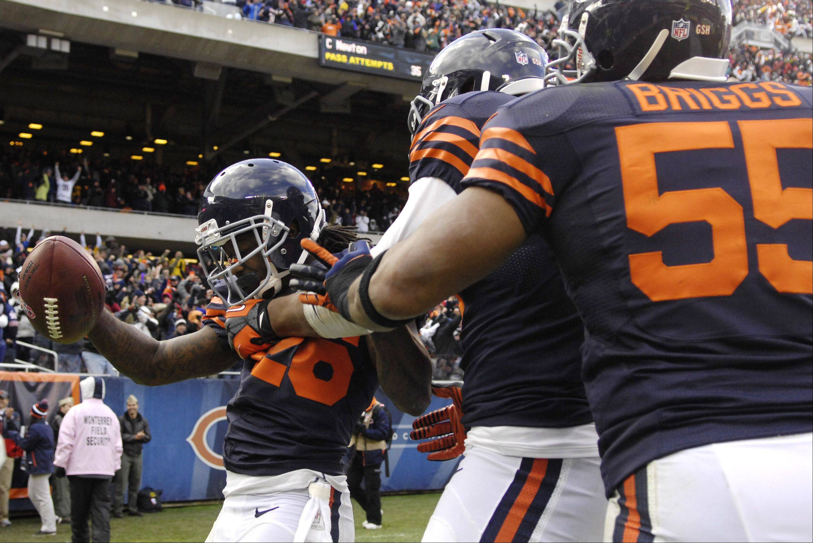 Chicago Bears cornerback Tim Jennings (26) is swarmed by teammates after his fourth-quarter interception return for a touchdown during Sunday's game against Carolina at Soldier Field in Chicago.