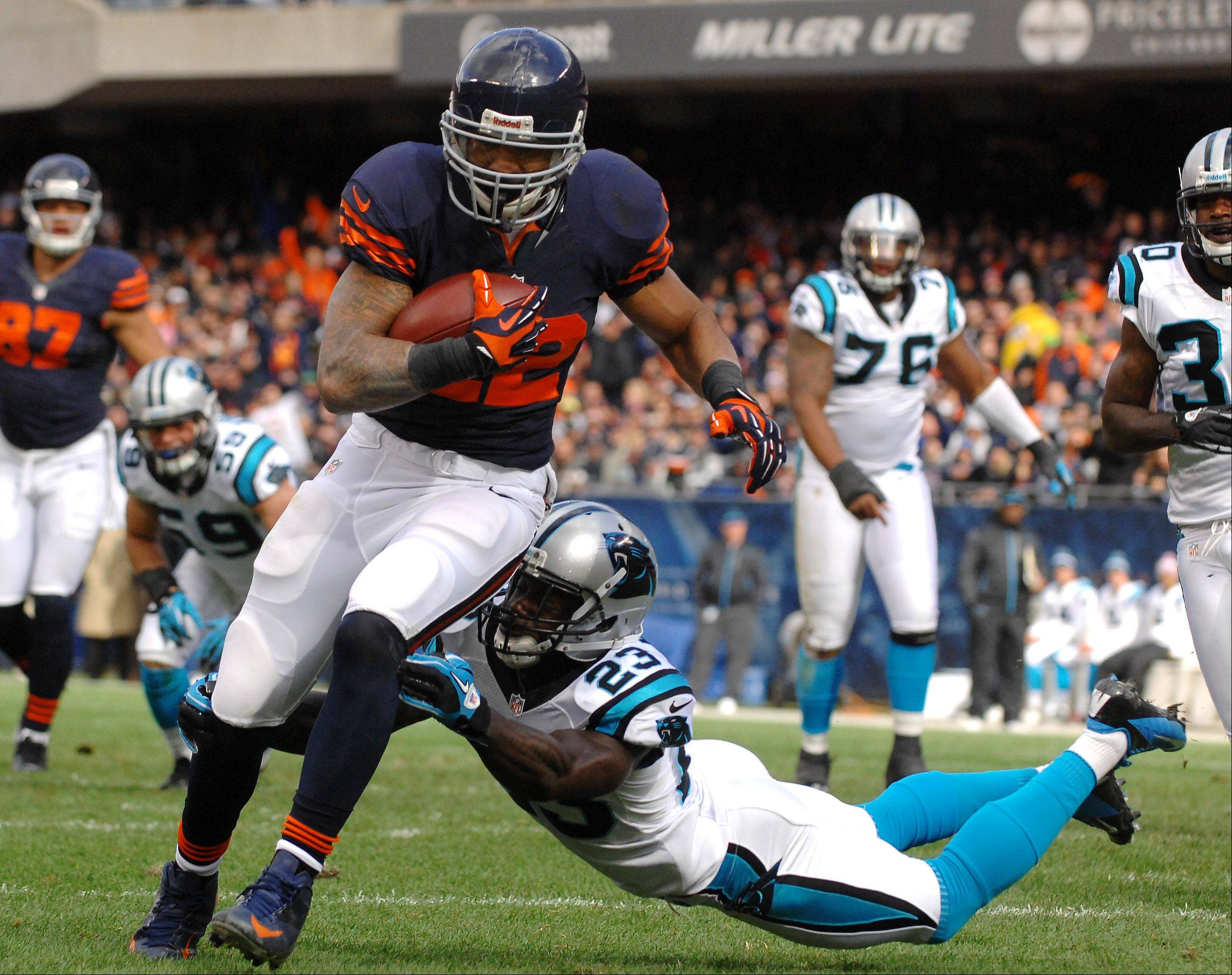 Chicago Bears running back Matt Forte (22) scores a first-quarter touchdown after eluding Carolina Panthers free safety Sherrod Martin (23) during Sunday's game at Soldier Field in Chicago.