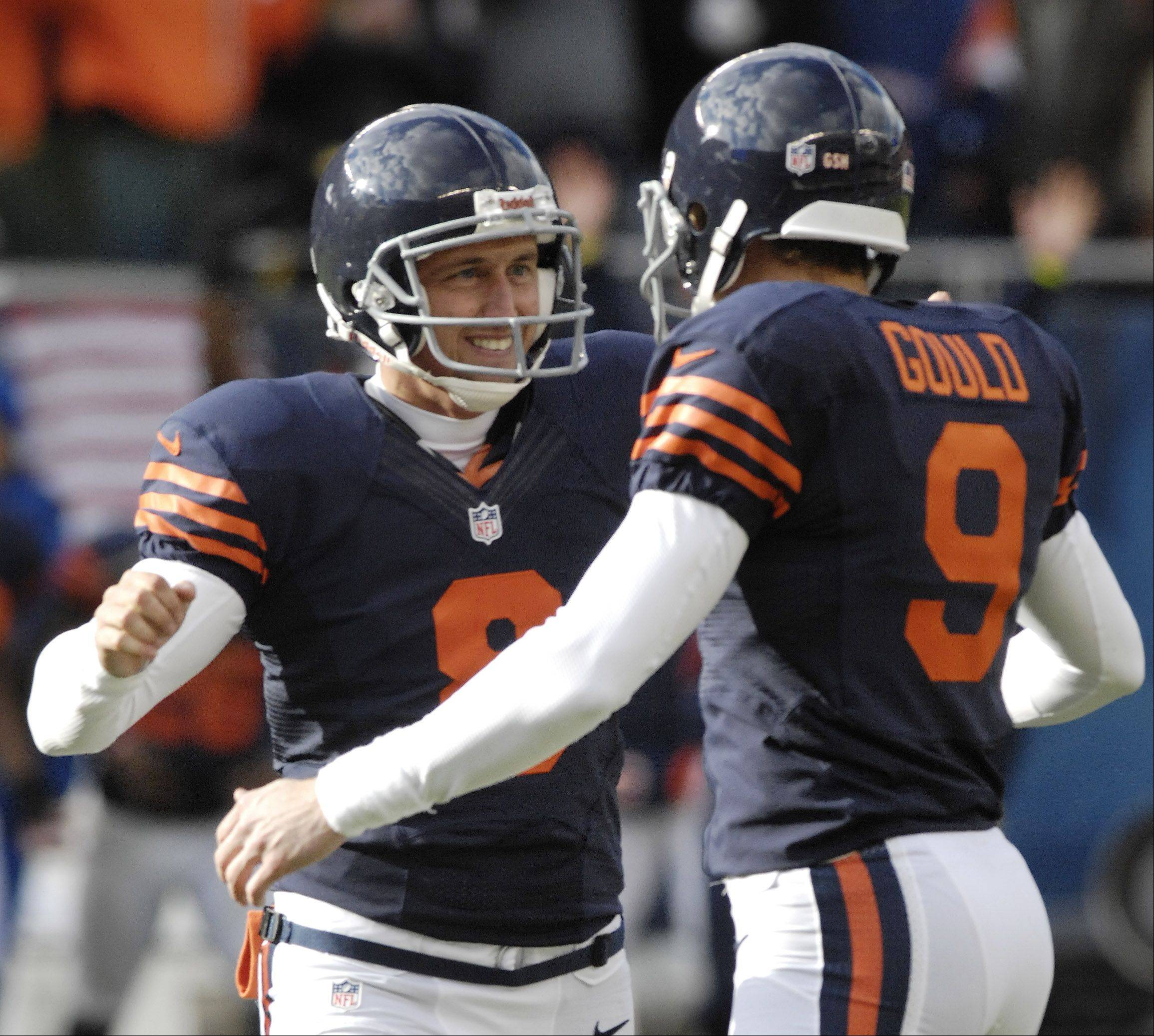 Chicago Bears kicker Robbie Gould, right, celebrates his game-winning field goal with holder Adam Podlesh during Sunday's game at Soldier Field.