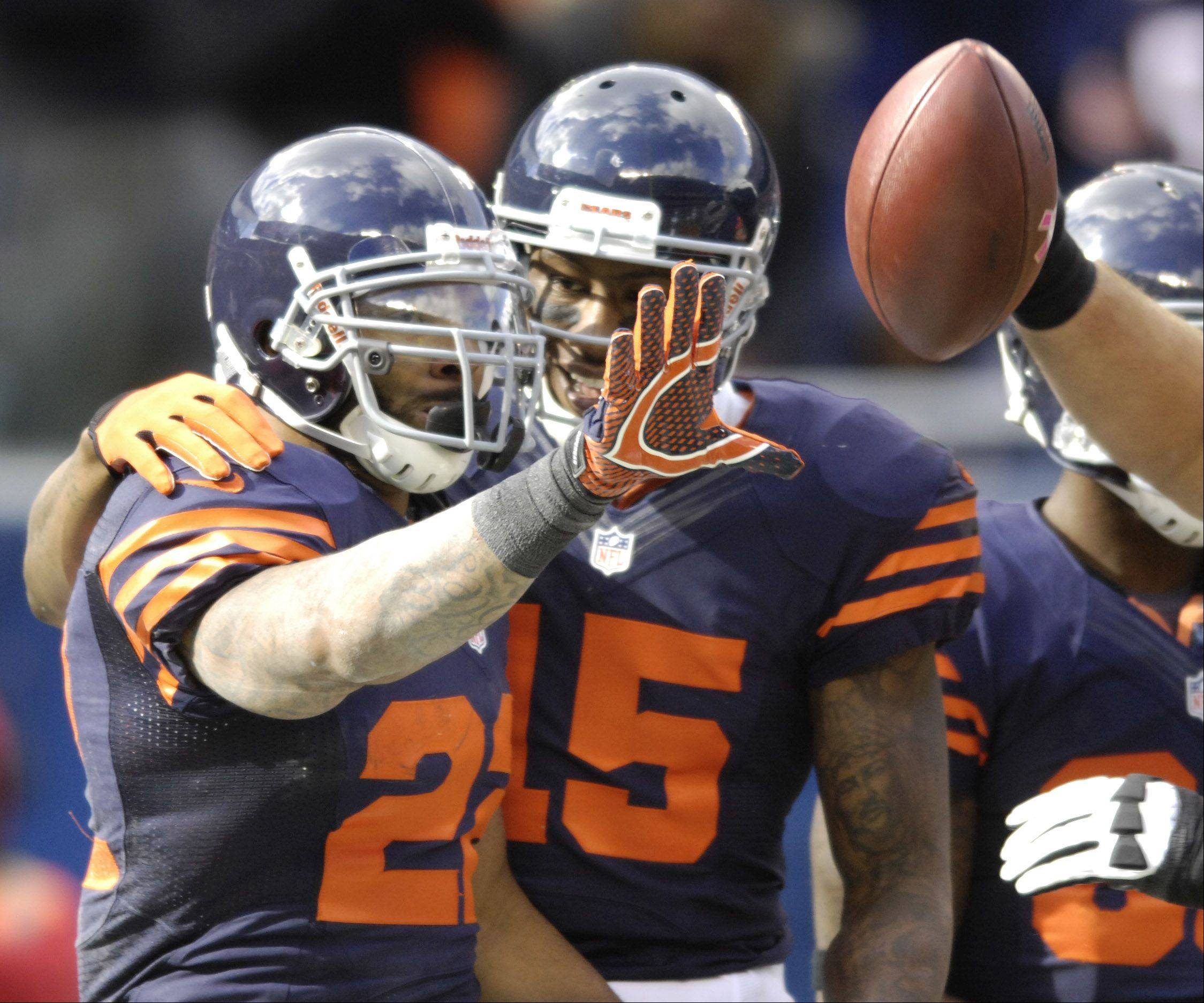 Chicago Bears running back Matt Forte left, celebrates his touchdown with Chicago Bears wide receiver Brandon Marshall during Sunday's game against the Carolina Panthers at Soldier Field.