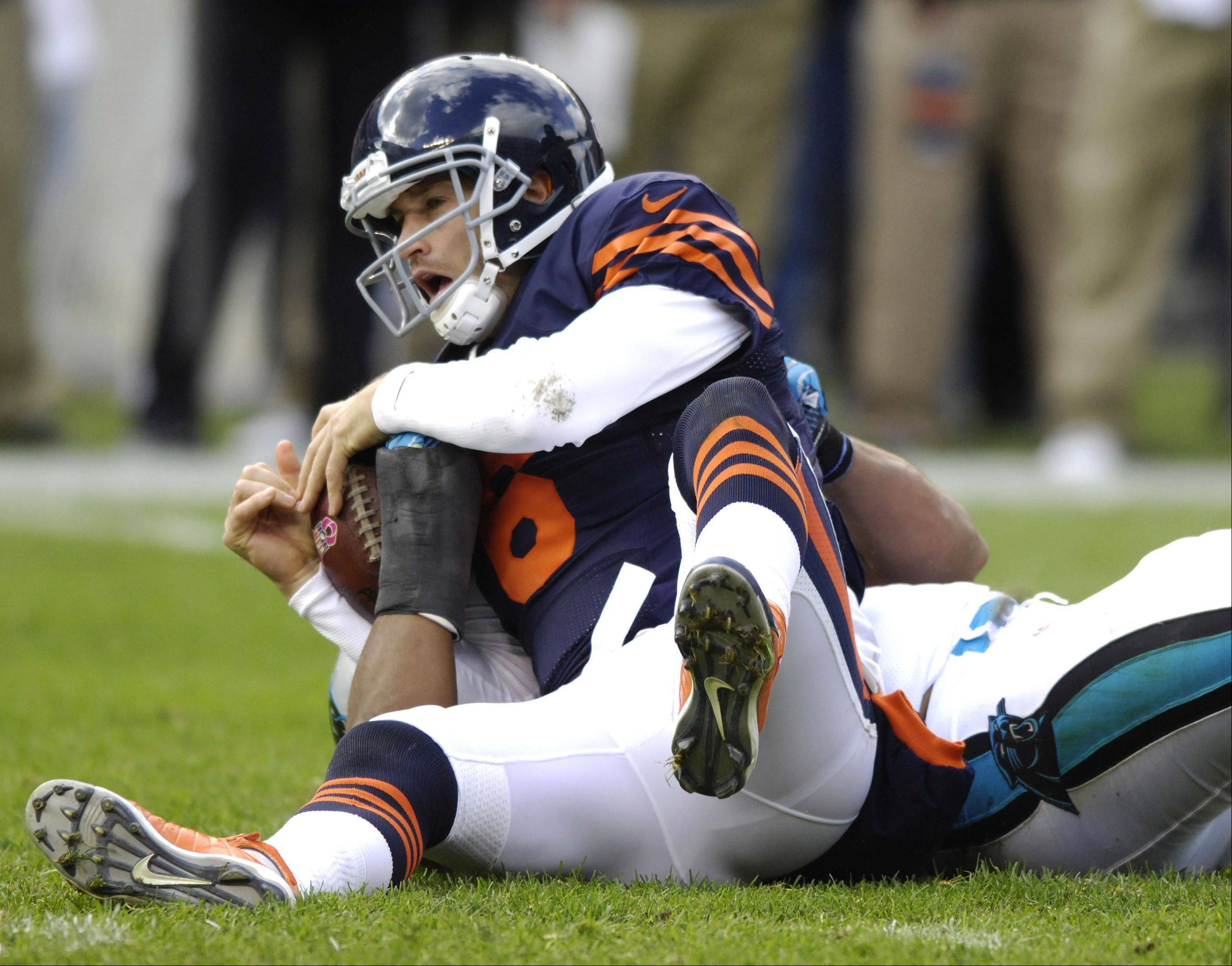 Chicago Bears quarterback Jay Cutler gets sacked during the second quarter of Sunday's game against the Carolina Panthers at Soldier Field.