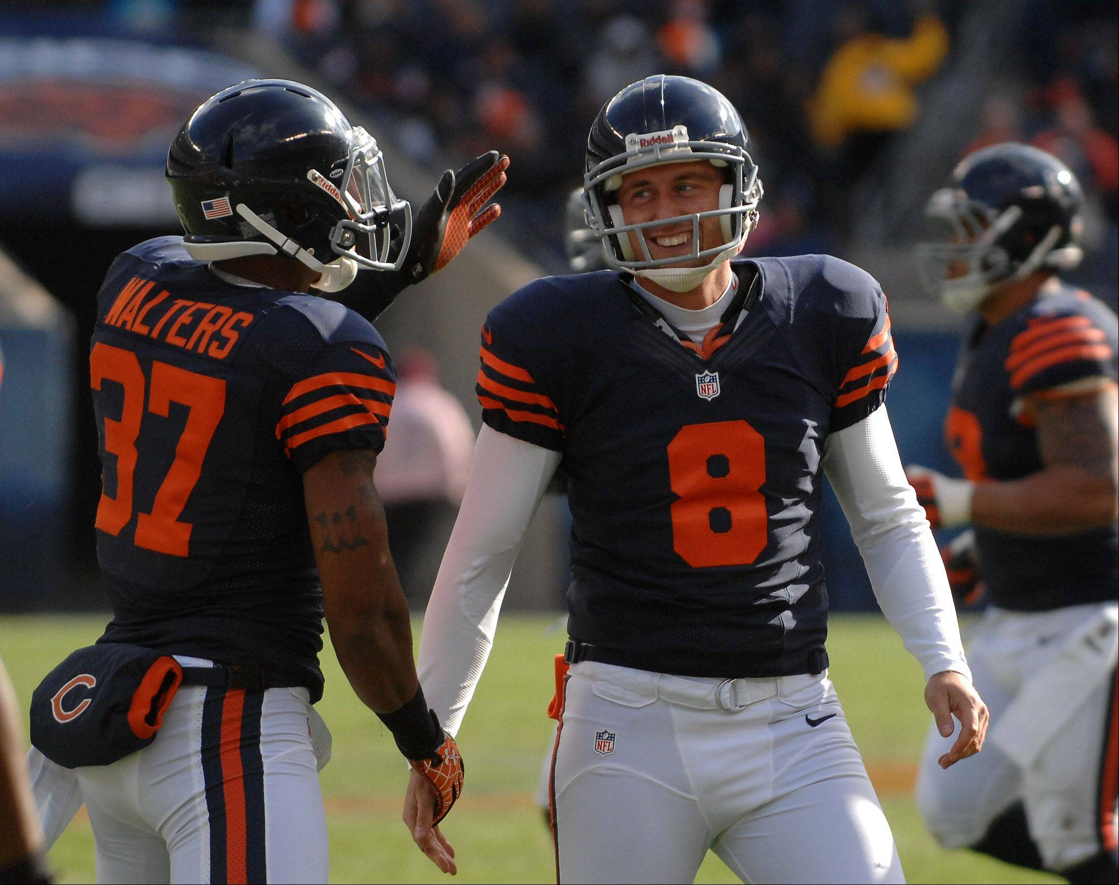 Chicago Bears punter Adam Podlesh (8) and Chicago Bears Anthony Walters (37) are pleased after pinning the Panthers inside the 10 on a punt during Sunday's game at Soldier Field in Chicago.