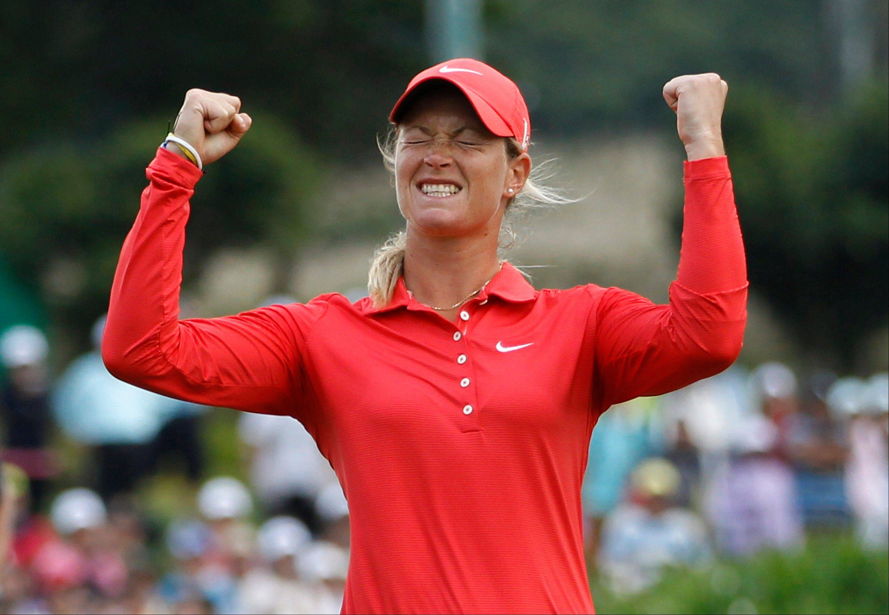 Suzann Pettersen from Norway, reacts on the 18th green after winning the Taiwan Championship at the Sunrise Golf & Country Club, Sunday in Yang Mei, Taiwan. Pettersen closed with a 3-under 69 at Sunrise to finish at 19 under and earned $300,000 for her 10th LPGA Tour title.