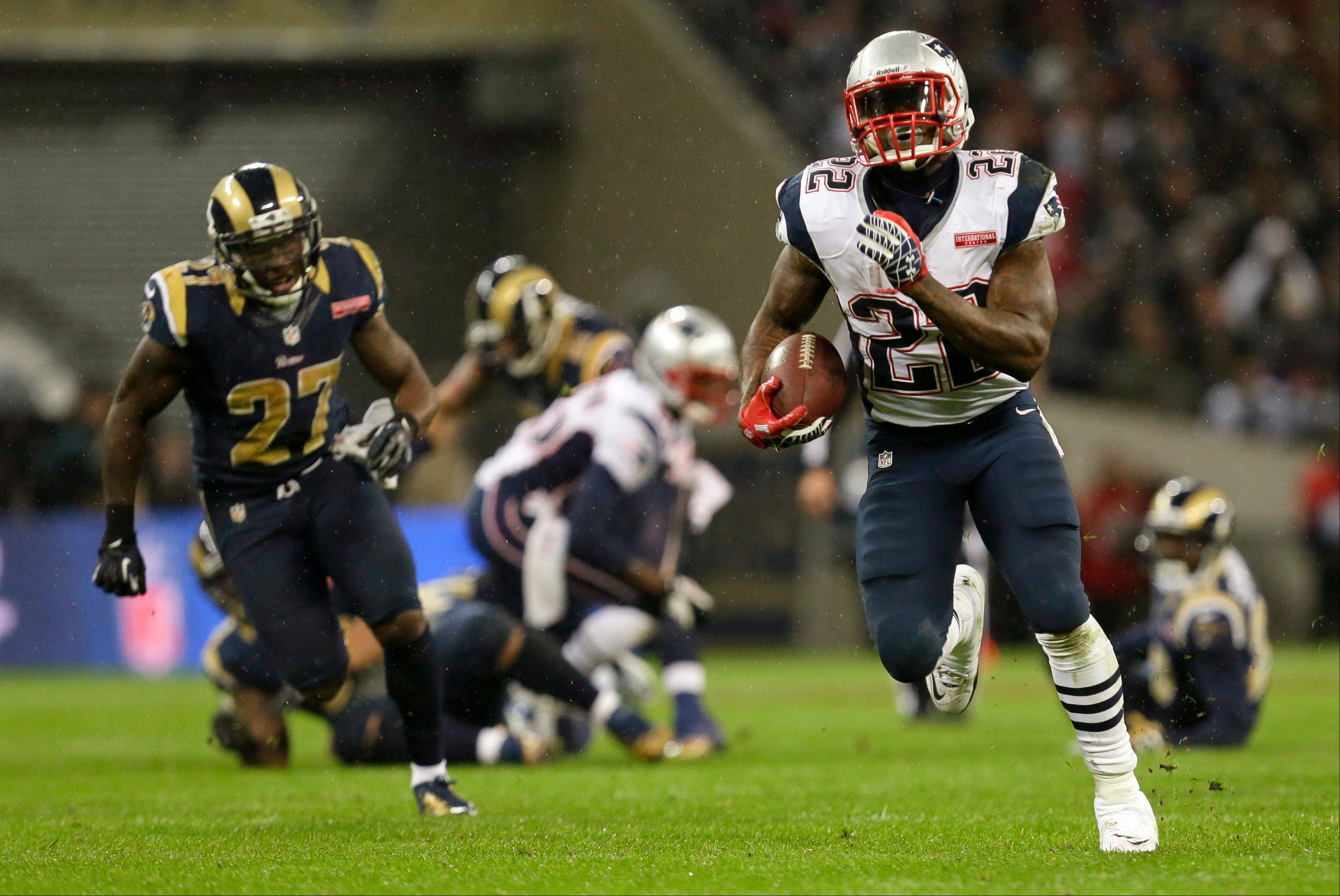 New England Patriots running back Stevan Ridley, right, with St. Louis Rams free safety Quintin Mikell, left, in action during the second half of a NFL football game at Wembley Stadium, London, Sunday.