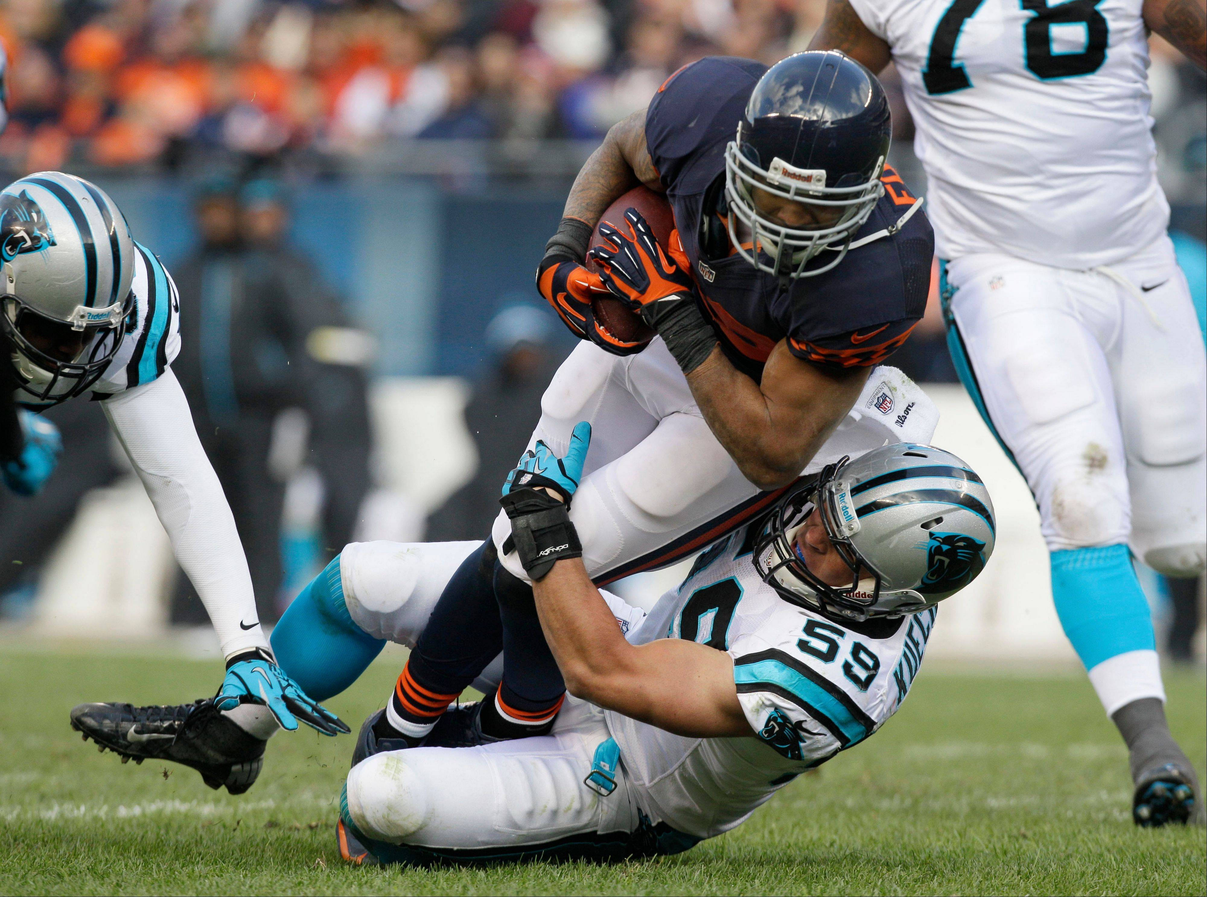 Chicago Bears running back Matt Forte is tackled by Carolina Panthers linebacker Luke Kuechly (59) during the second half of an NFL football game in Chicago, Sunday.