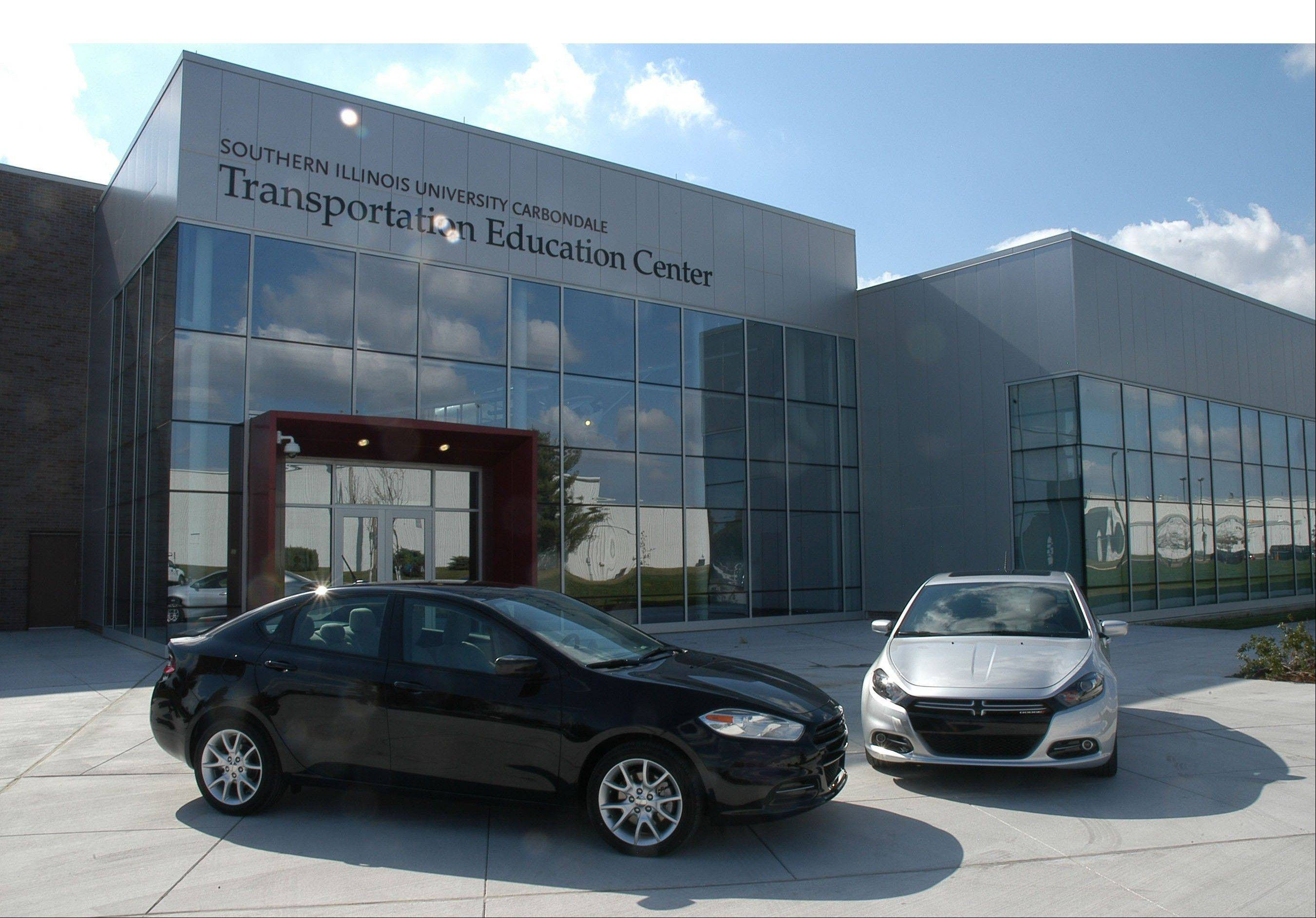 Chrysler Group is donating this black 2013 Dodge Dart to the automotive technology program at Southern Illinois University Carbondale. The Dart was presented today during a grand opening celebration at SIUC's new Transportation Education Center. The Dart is assembled at Chrysler Group's Belvidere, Ill. Assembly Plant. (PRNewsFoto/Chrysler Group LLC)