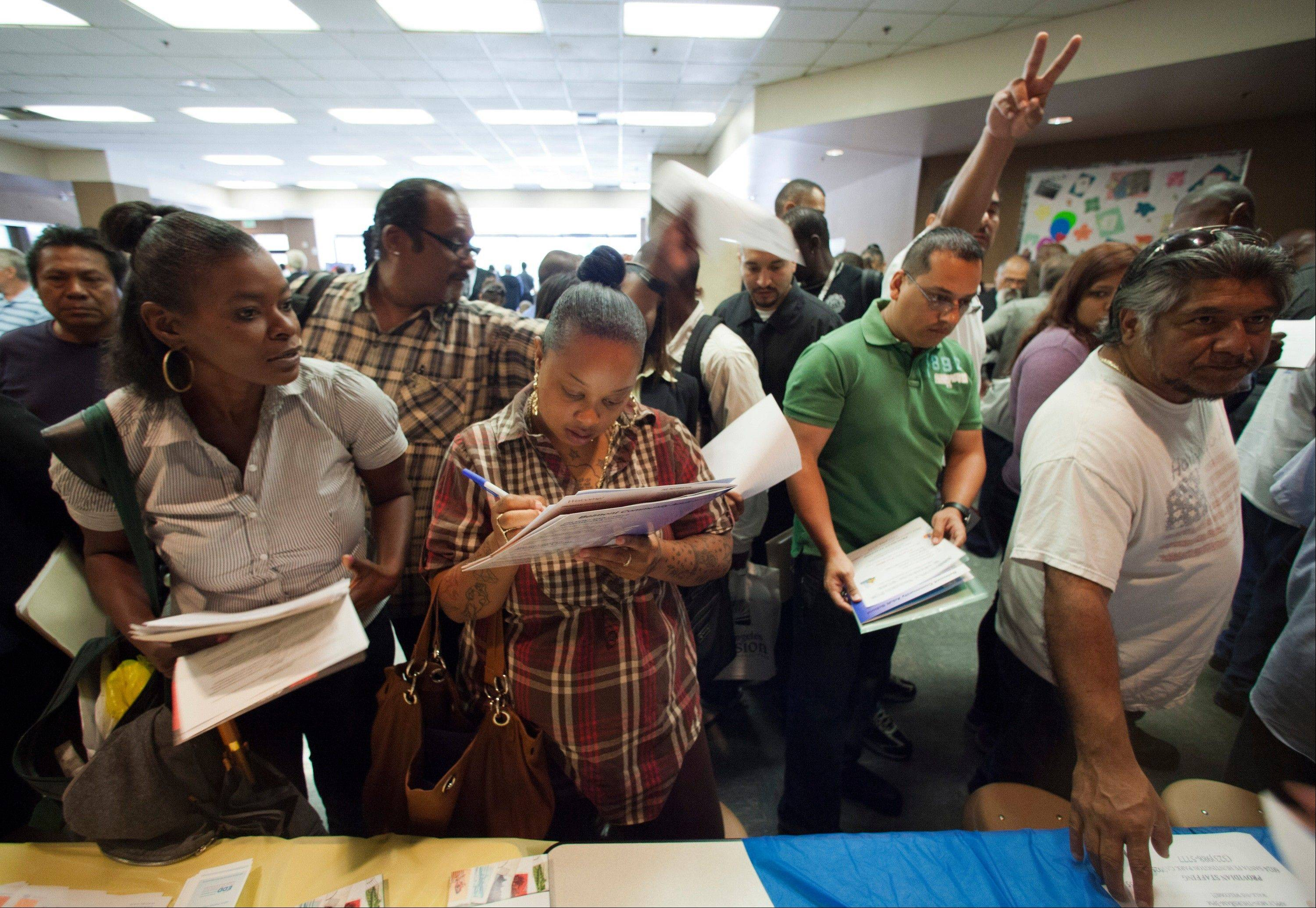 Job seekers gather for employment opportunities at a jobs fair last May in Los Angeles. Hurricane Sandy may delay Friday's scheduled release of the October jobs report.