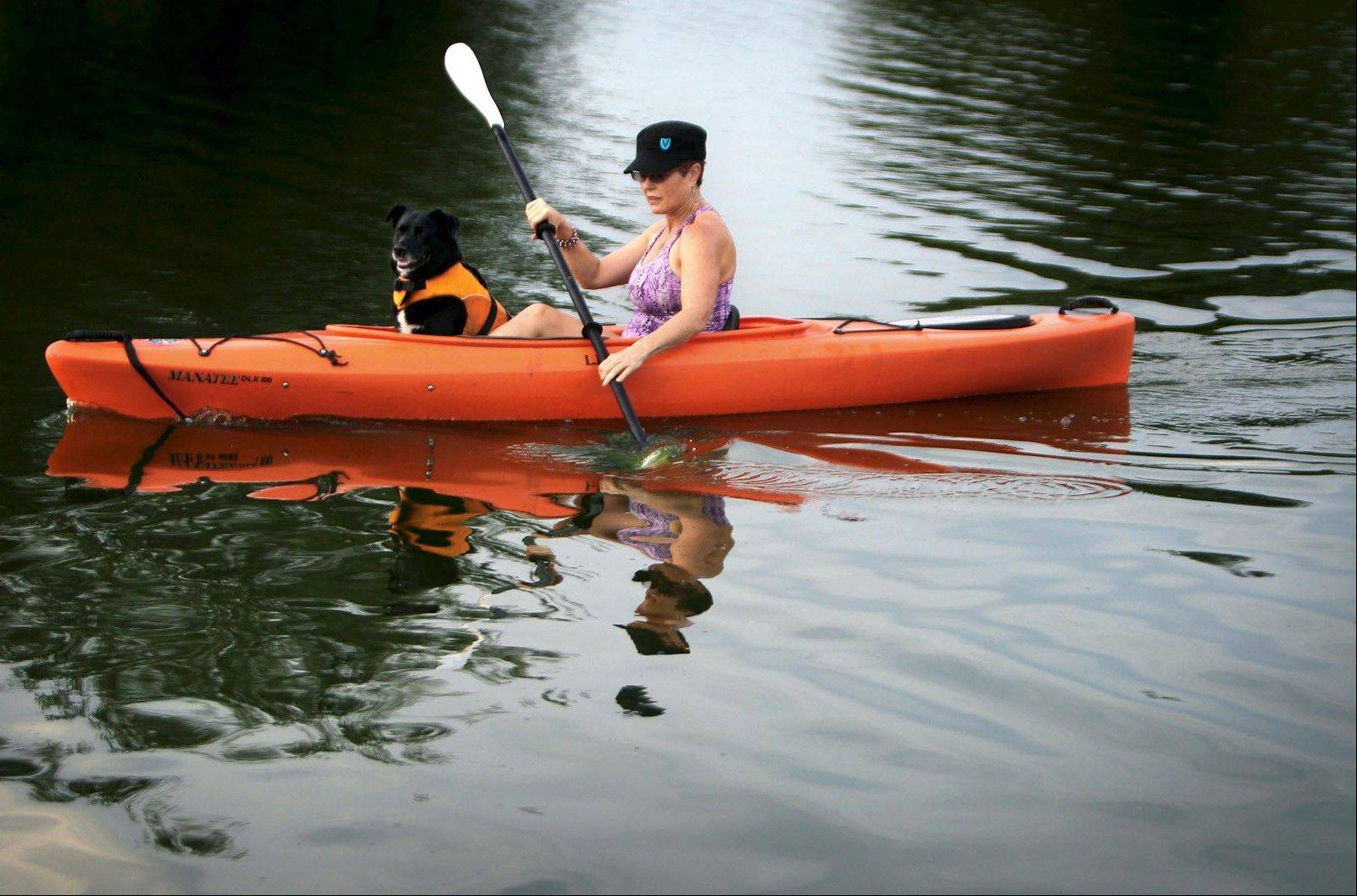 Sharon King kayaks on Patriot Lake at Shelby Farms in Memphis with her Lab-border-collie mix, Ashok. King said she mostly runs for exercise, but has turned to kayaking to work her upper body and core.