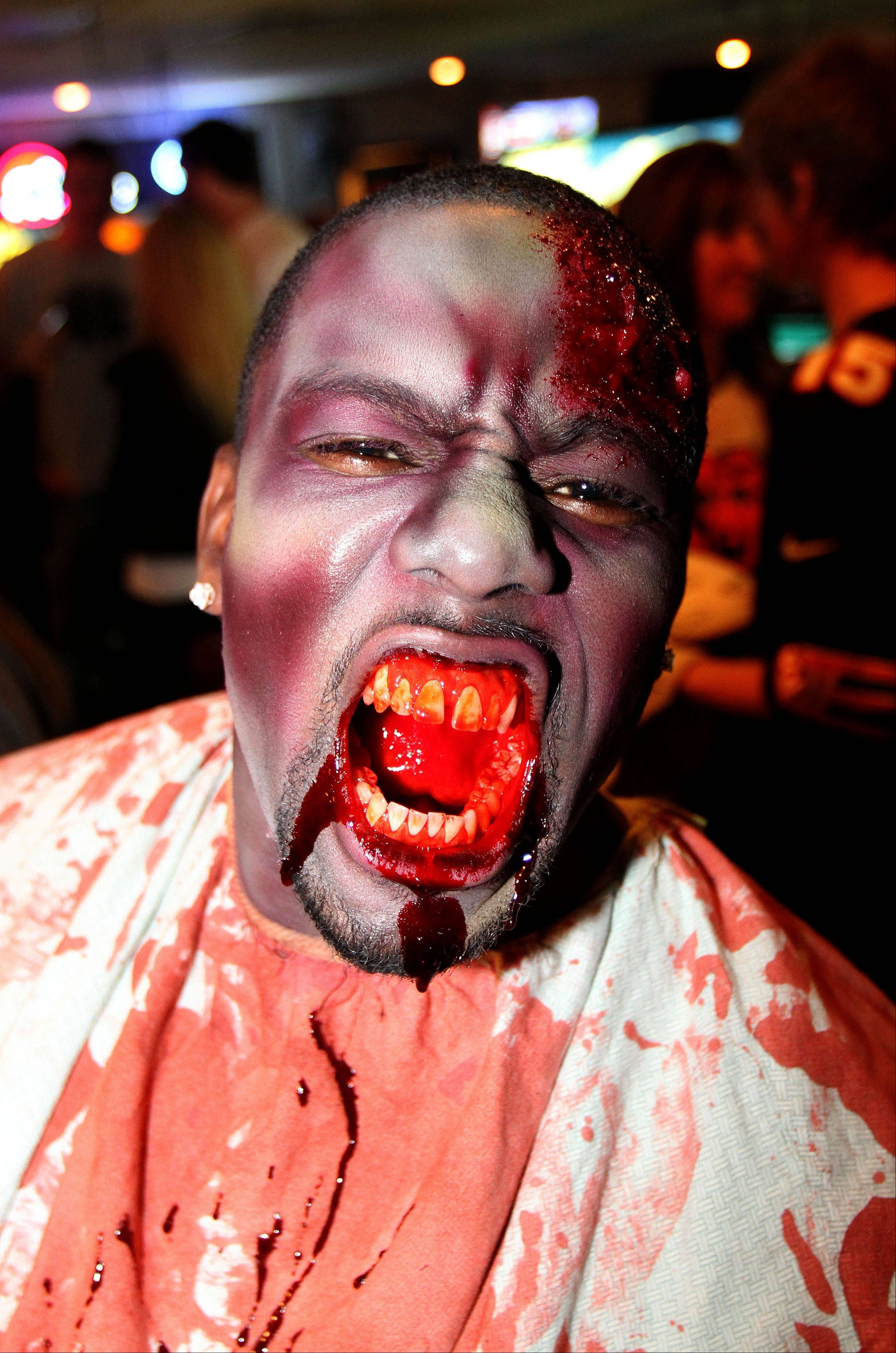Defensive end Cheta Ozougwu portrays a ghoul at the Realm of Terror haunted house at Kristof's Family Fun Center in Round Lake Beach Monday.