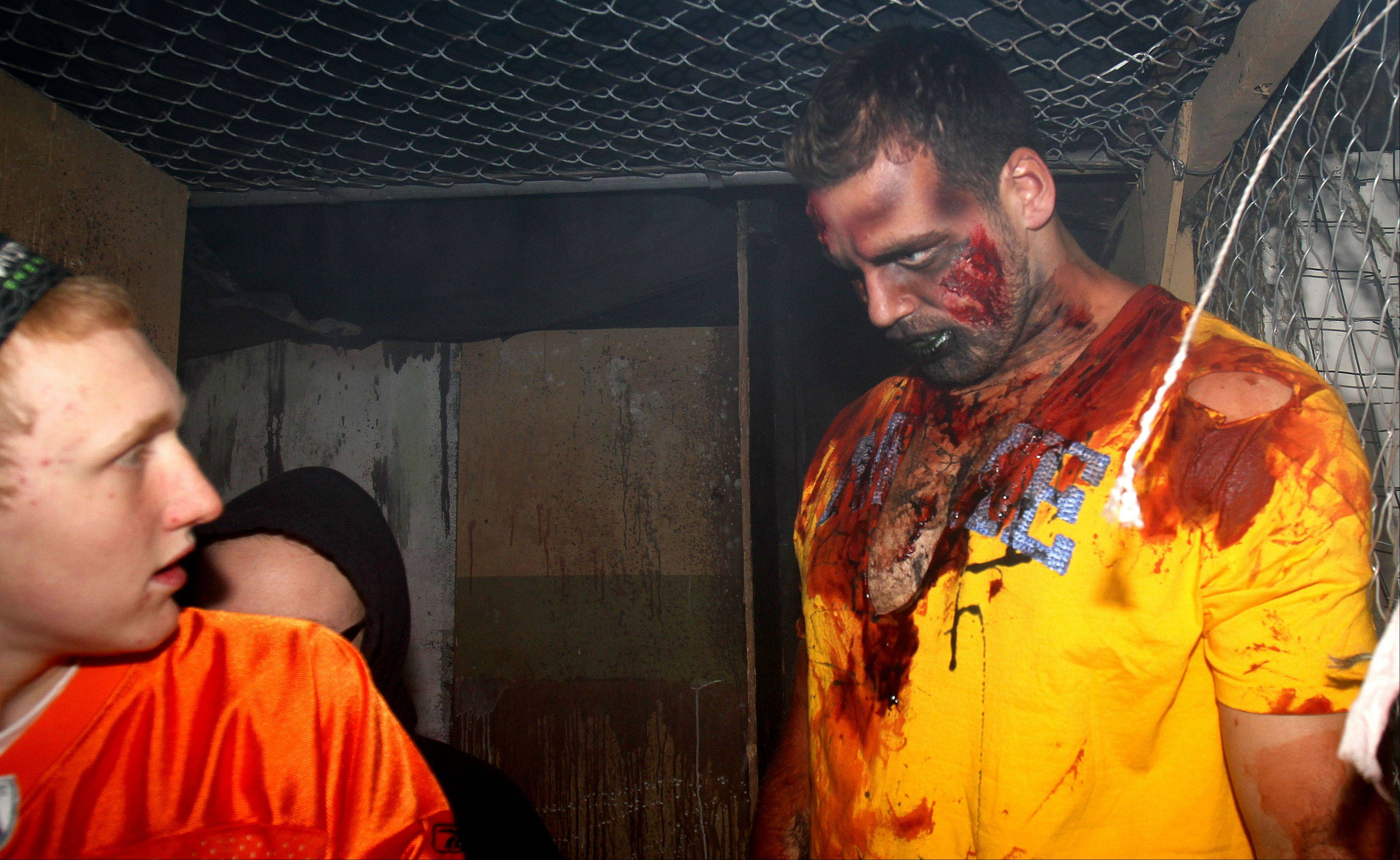 Bears offensive lineman Gabe Carimi scares visitors to the Realm of Terror haunted house at Kristof's Family Fun Center on Monday in Round Lake Beach.