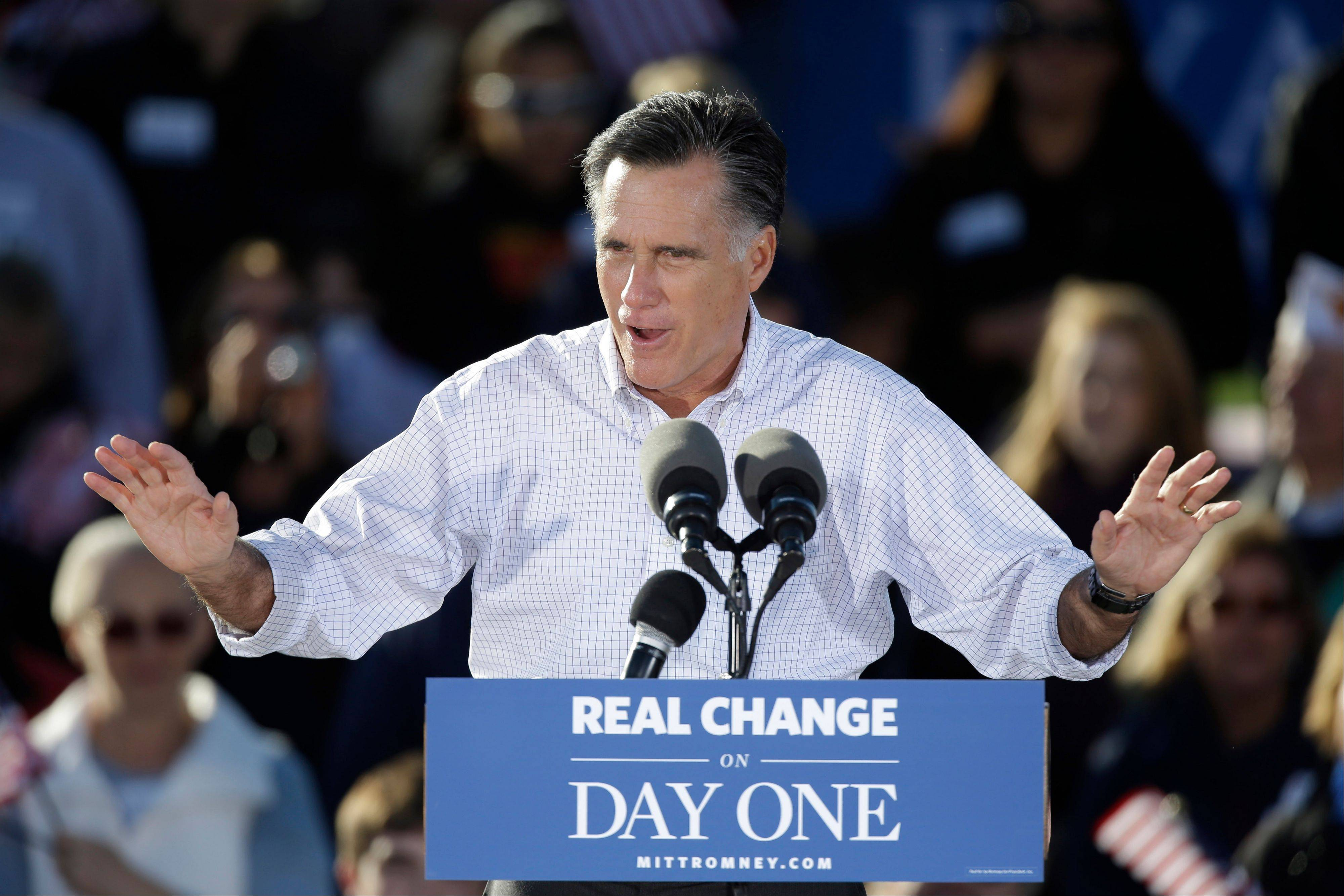 Republican presidential candidate and former Massachusetts Gov. Mitt Romney speaks during a campaign stop Monday in Davenport, Iowa.