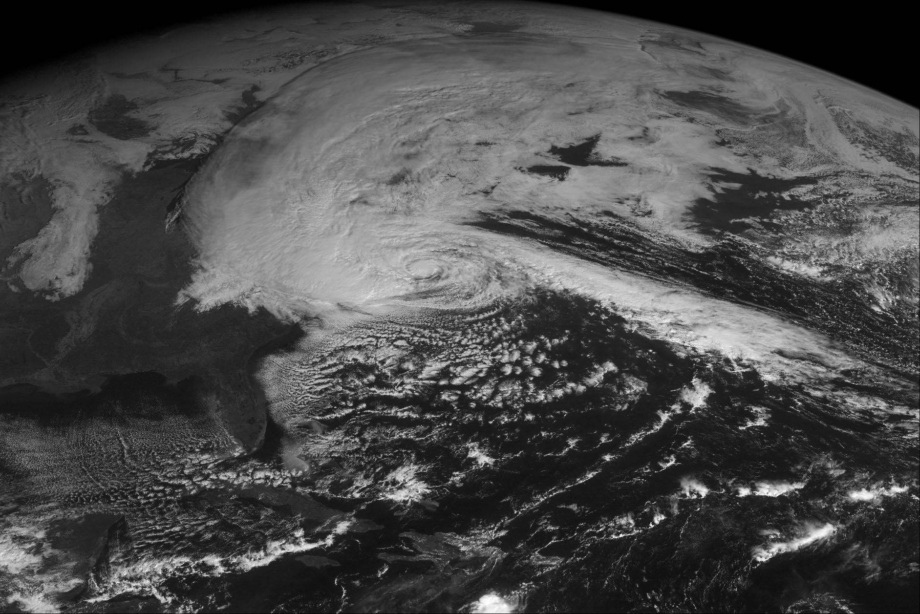 This NOAA satellite image taken Monday, Oct. 29, at 10:45 AM EDT shows Hurricane Sandy approaching the Mid-Atlantic region with clouds extending across much of the Northeast quarter of the U.S. with heavy rains from the Mid-Atlantic to the Ohio Valley and Great Lakes and snow falling in the southern portions of West Virginia. Cloudiness and rain showers can be found across the Upper and Mid Mississippi Valleys.