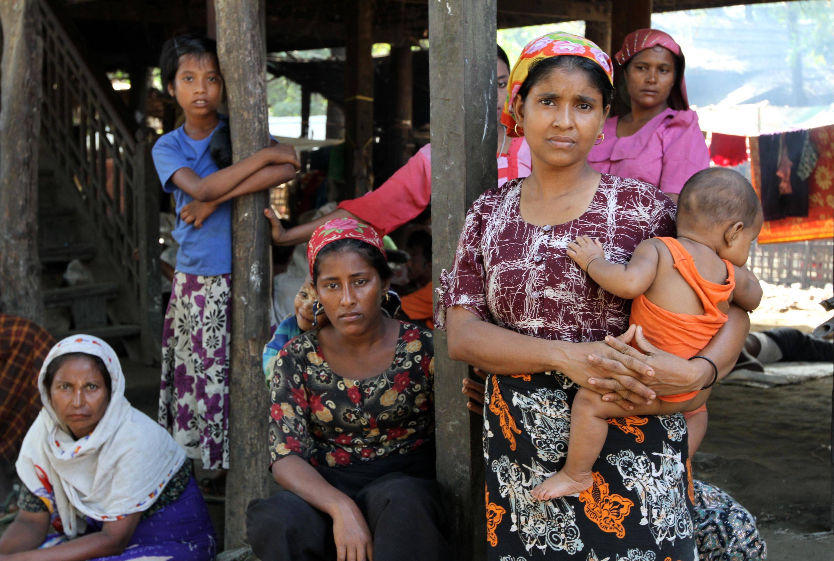 Muslim women gather at the Thae-Chaung refugee camp in Sittwe, Rakhine State, western Myanmar, Monday. Myanmar's government said Monday it has boosted security in the western state hit by ethnic and sectarian unrest as the number of displaced rose to 28,000 people, mostly Muslims.