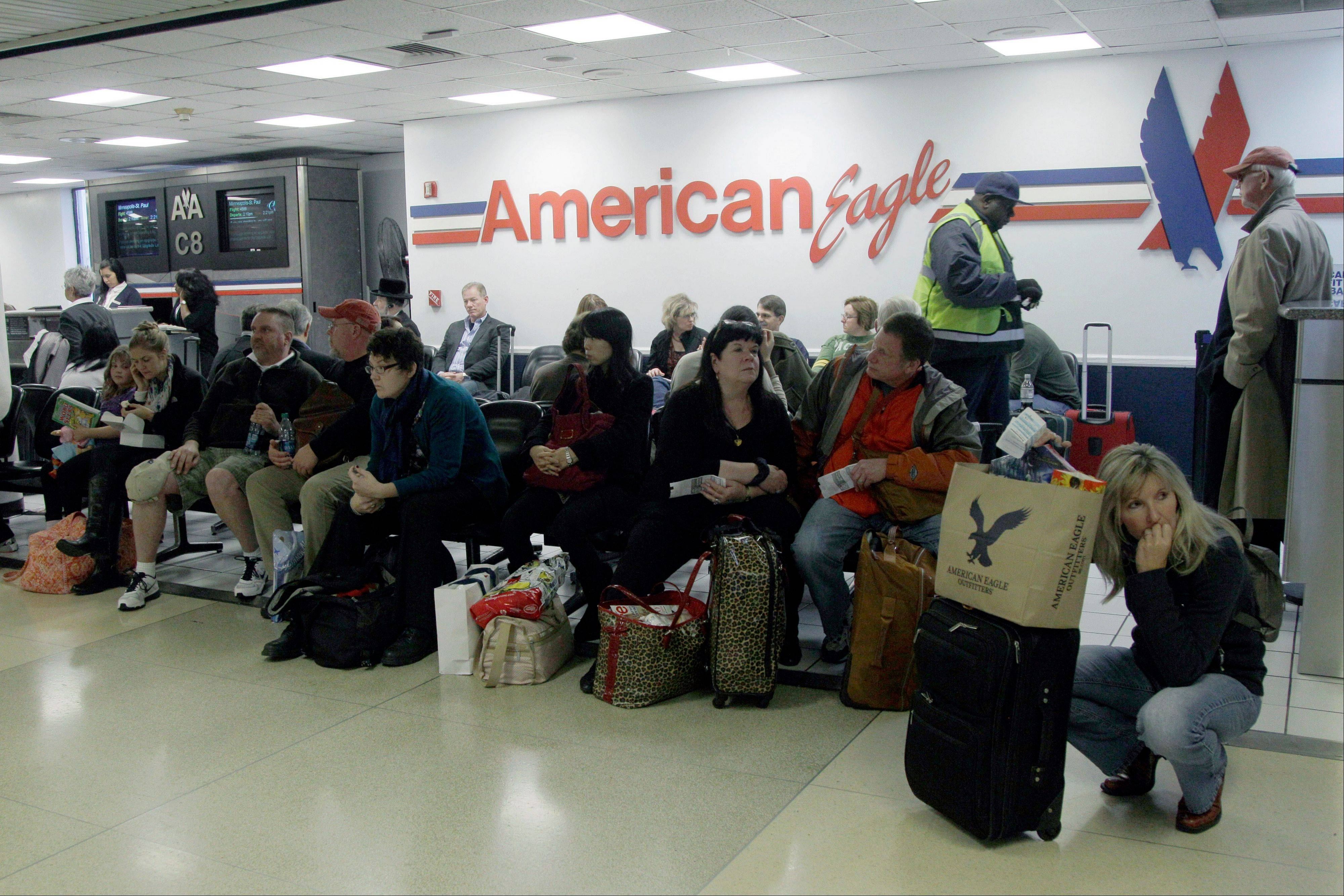 Passengers wait for their flight at LaGuardia airport in New York Sunday. Hurricane Sandy grounded thousands of flights in the U.S. northeast Monday.