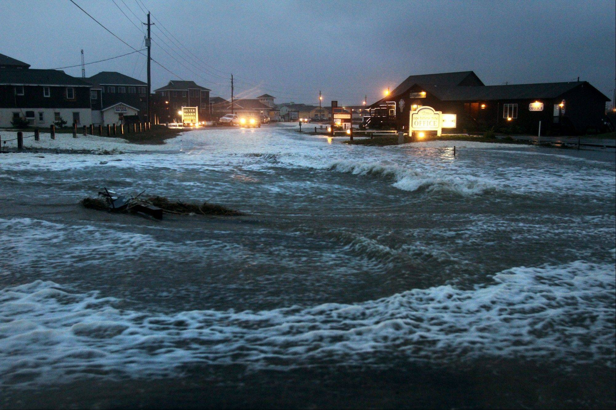 Ocean water rolls over state highway NC 12 in Buxton, N.C., on Hatteras Island at dawn on Sunday as Hurricane Sandy works its way north, battering the U.S. East Coast.