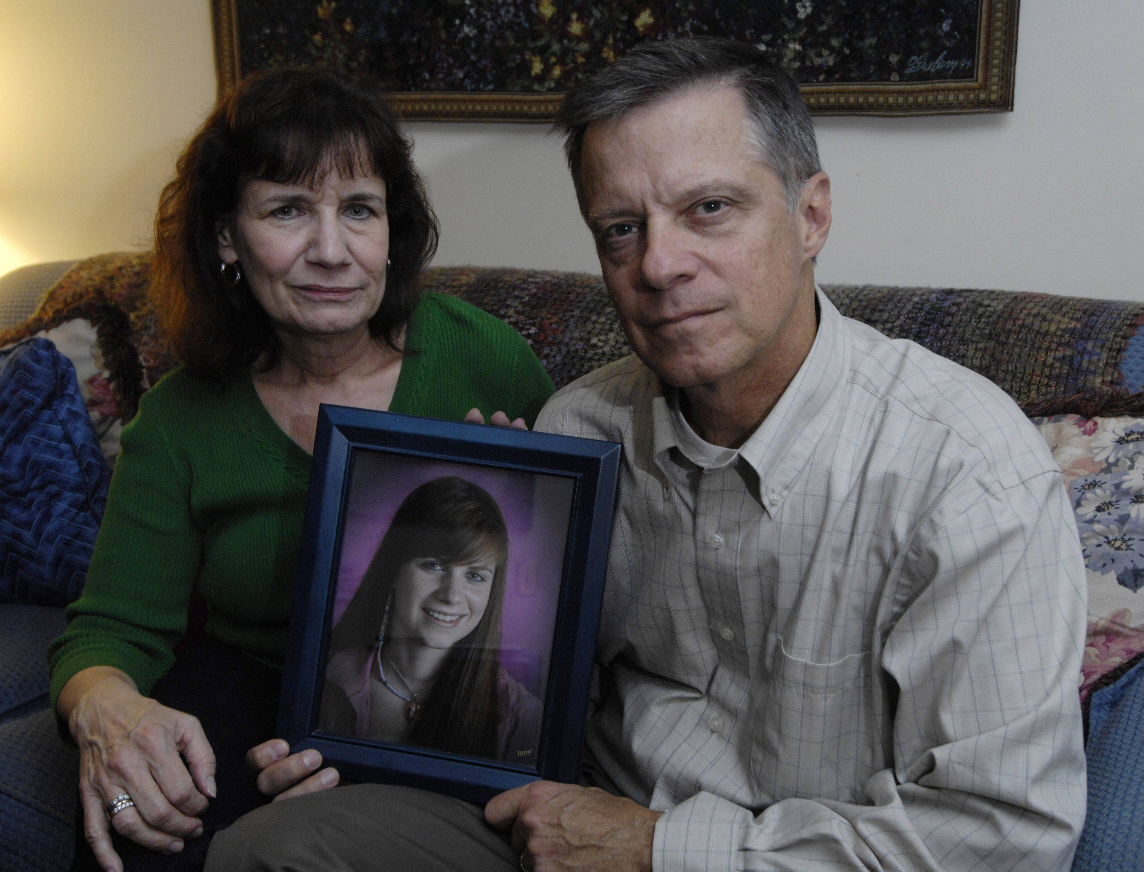 Peter Jackson and his wife, Ellen, of Arlington Heights, hold a picture of their 18-year-old daughter Emily, who died after taking a single OxyContin pill. The couple have urged federal authorities for tighter restrictions on such opioid painkillers.