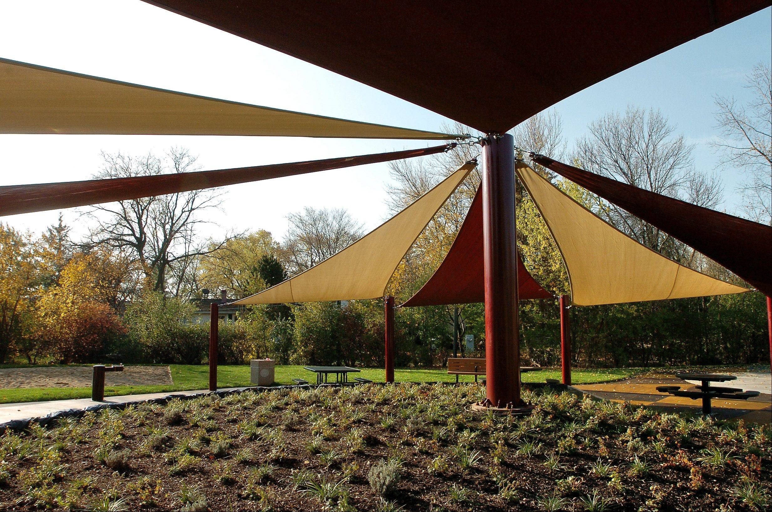 Landscaped area underneath fabric shade shelter at the new Tropicana Park in Hoffman Estates.