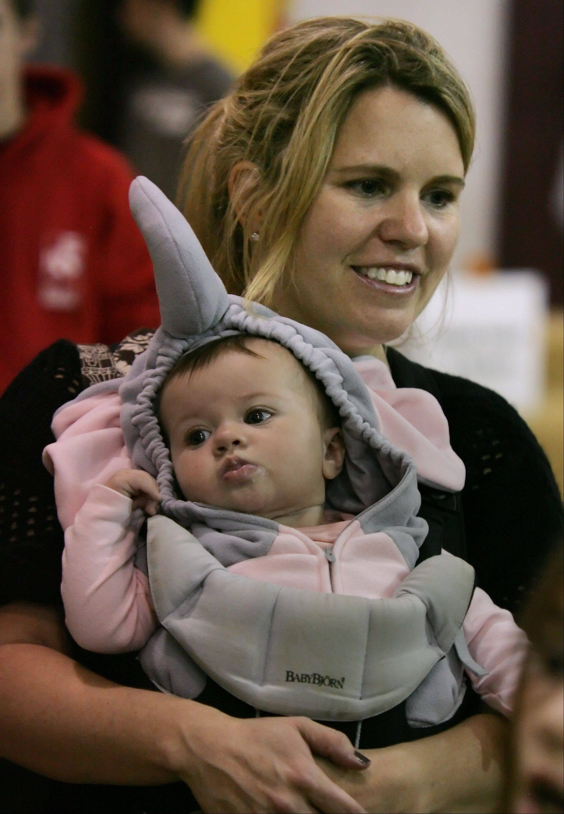 Meaghen Dahm holds five-month-old Emerson, dressed as an elephant, during the 5th Annual Pumpkin Fest Thursday at the Grayslake Recreation Center. The Halloween event featured costumed characters, Halloween crafts, games, and trick or treats.