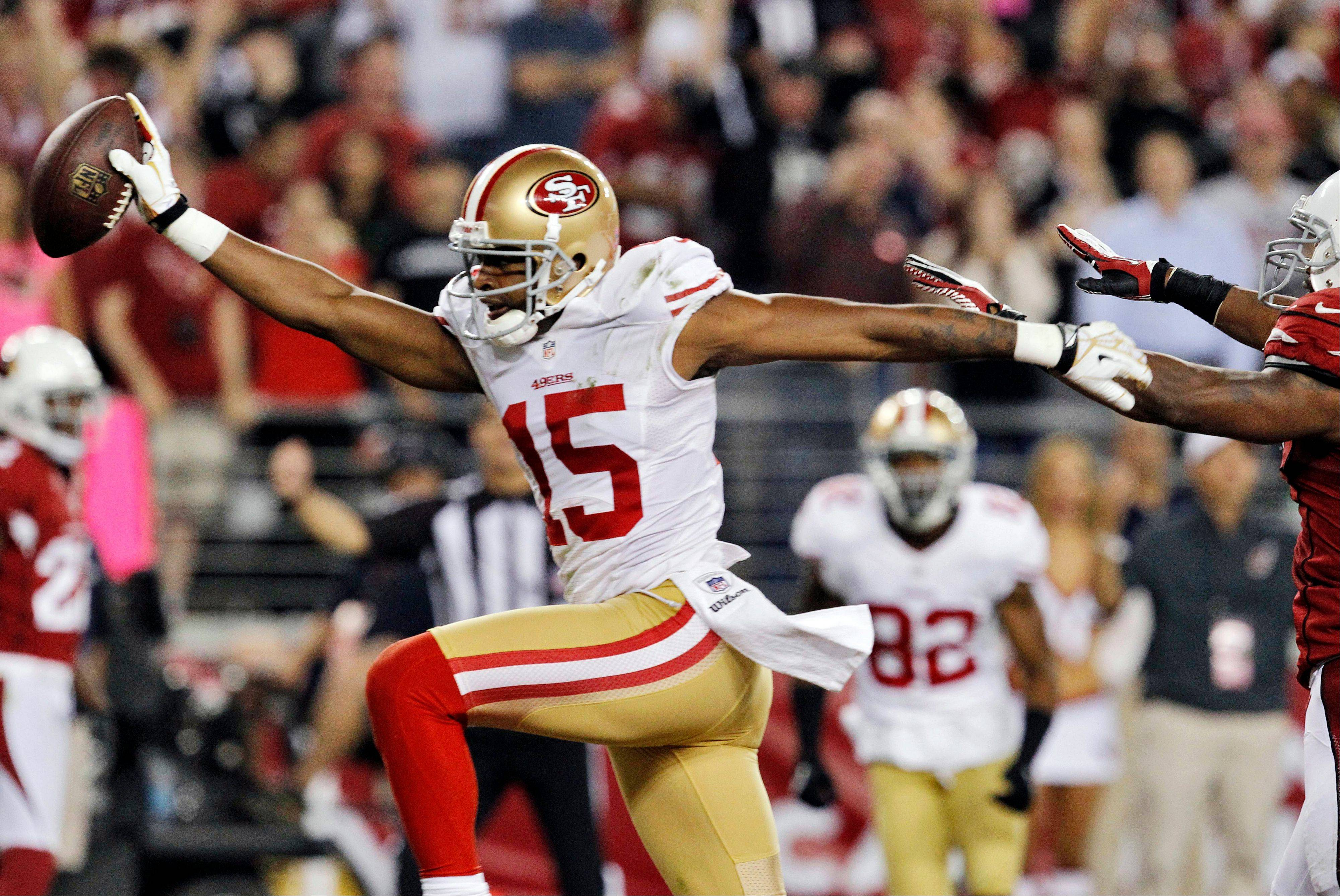 San Francisco 49ers wide receiver Michael Crabtree scores a touchdown against the Arizona Cardinals during the first half Monday in Glendale, Ariz.