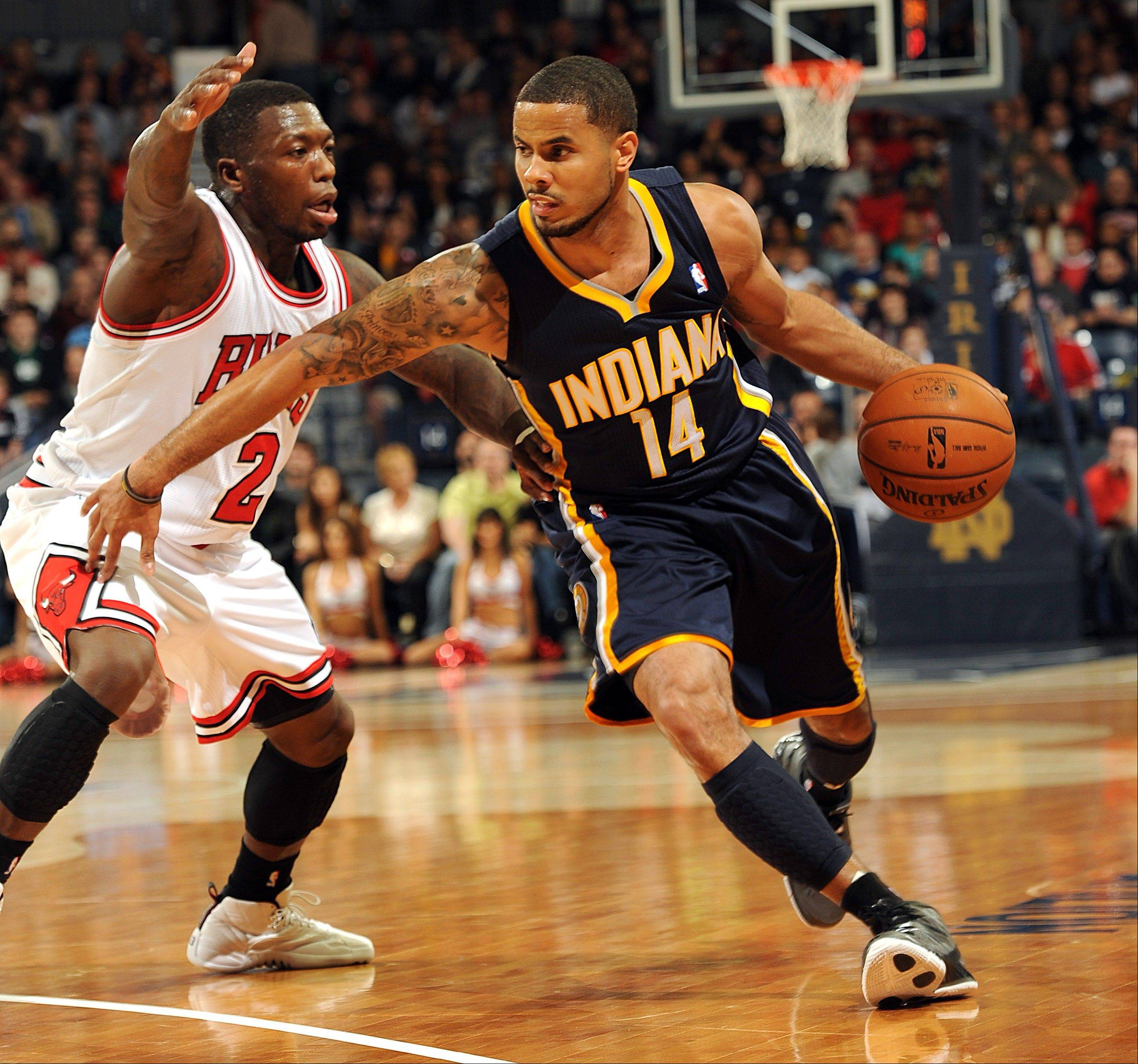 Bulls guard Nate Robinson, left, guards Indiana's D.J. Augustin during a preseason game. Robinson is excited to be playing for the Bulls, saying it's a priviledge to put on the same uniform that Michael Jordan and Scottie Pippen donned.