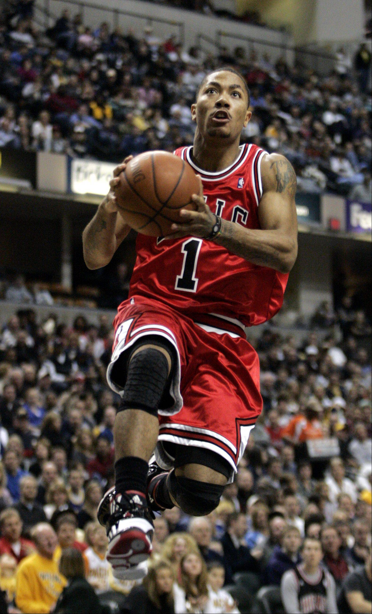 Bulls guard Derrick Rose drives toward the basket during the first half of an NBA basketball game against the Indiana Pacers in Indianapolis, Saturday, Feb. 27, 2010.