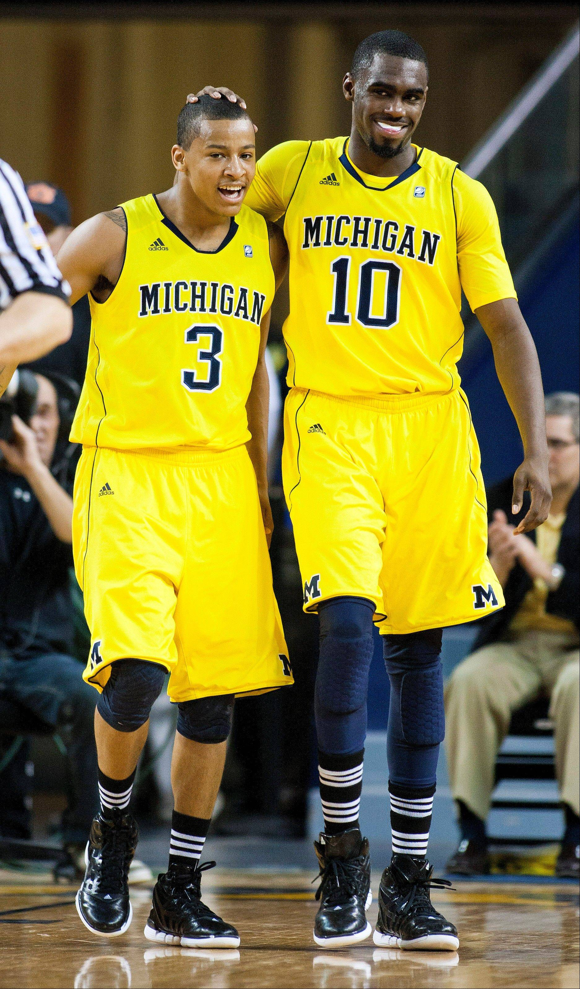 Michigan guards Trey Burke, left, and Tim Hardaway Jr. will be back for the 2012-13 season.
