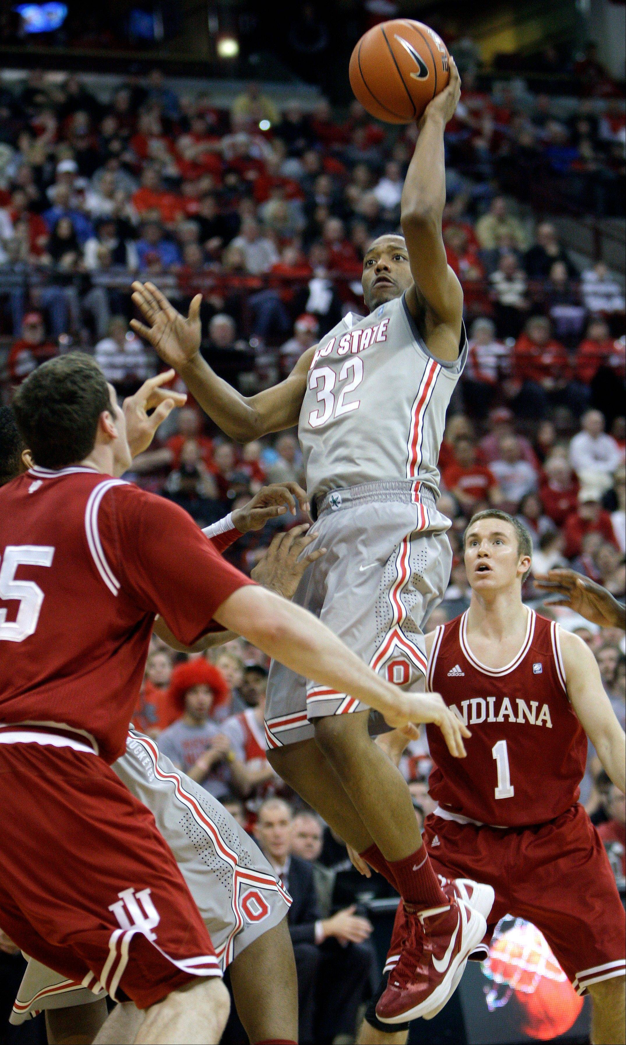Ohio State's Lenzelle Smith, top, shoots between Indiana's Tom Pritchard, left, and Kory Barnett during the second half of a game Jan. 15, 2012, in Columbus, Ohio. Smith is one of three returning starters for the Buckeyes.