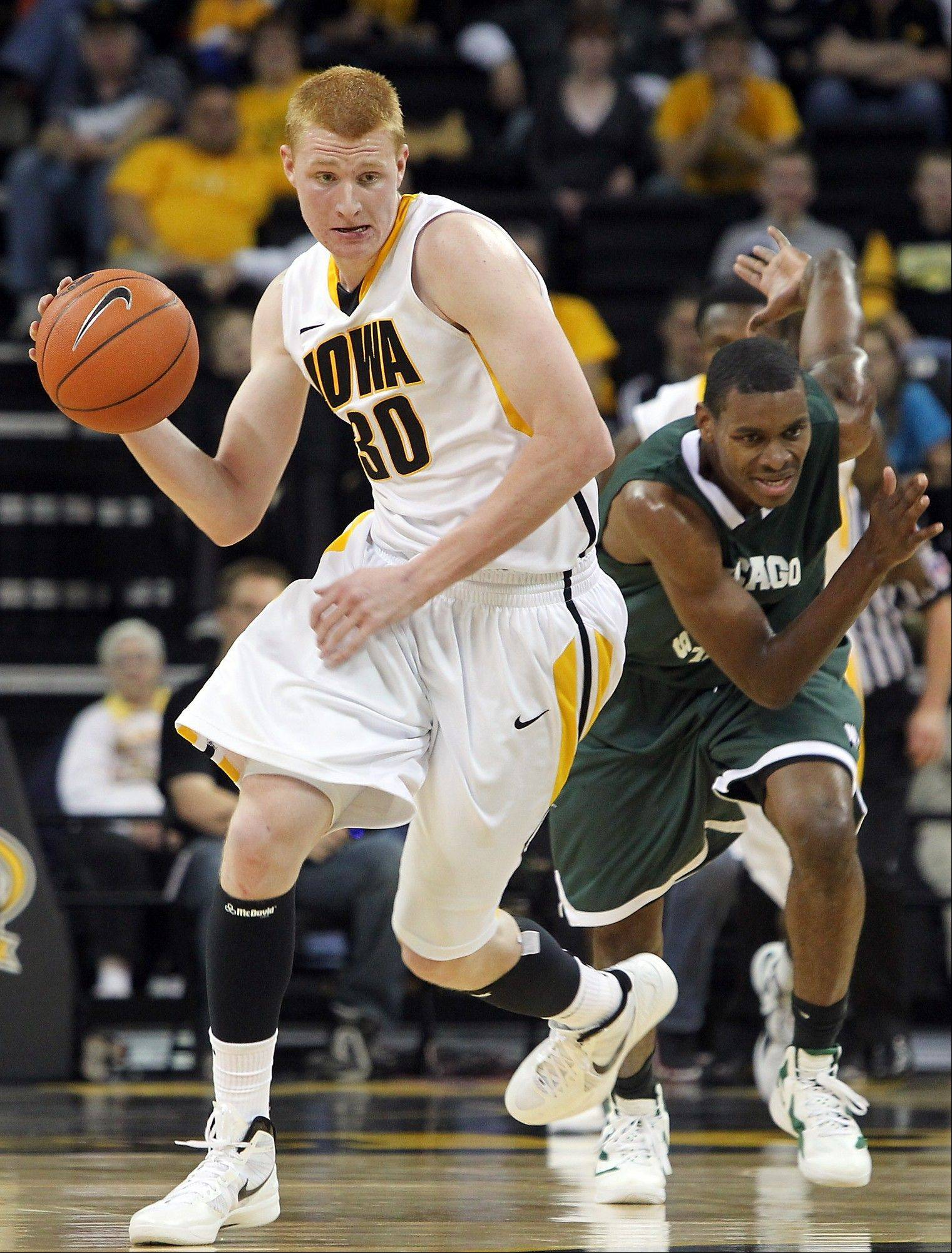 Iowa's Aaron White brings the ball down the court after getting a steal from Chicago State's D'Jari Nelson during a Nov. 11, 2011, game in Iowa City. White, a sophomore forward, was one of the Big Ten's biggest surprises last season.