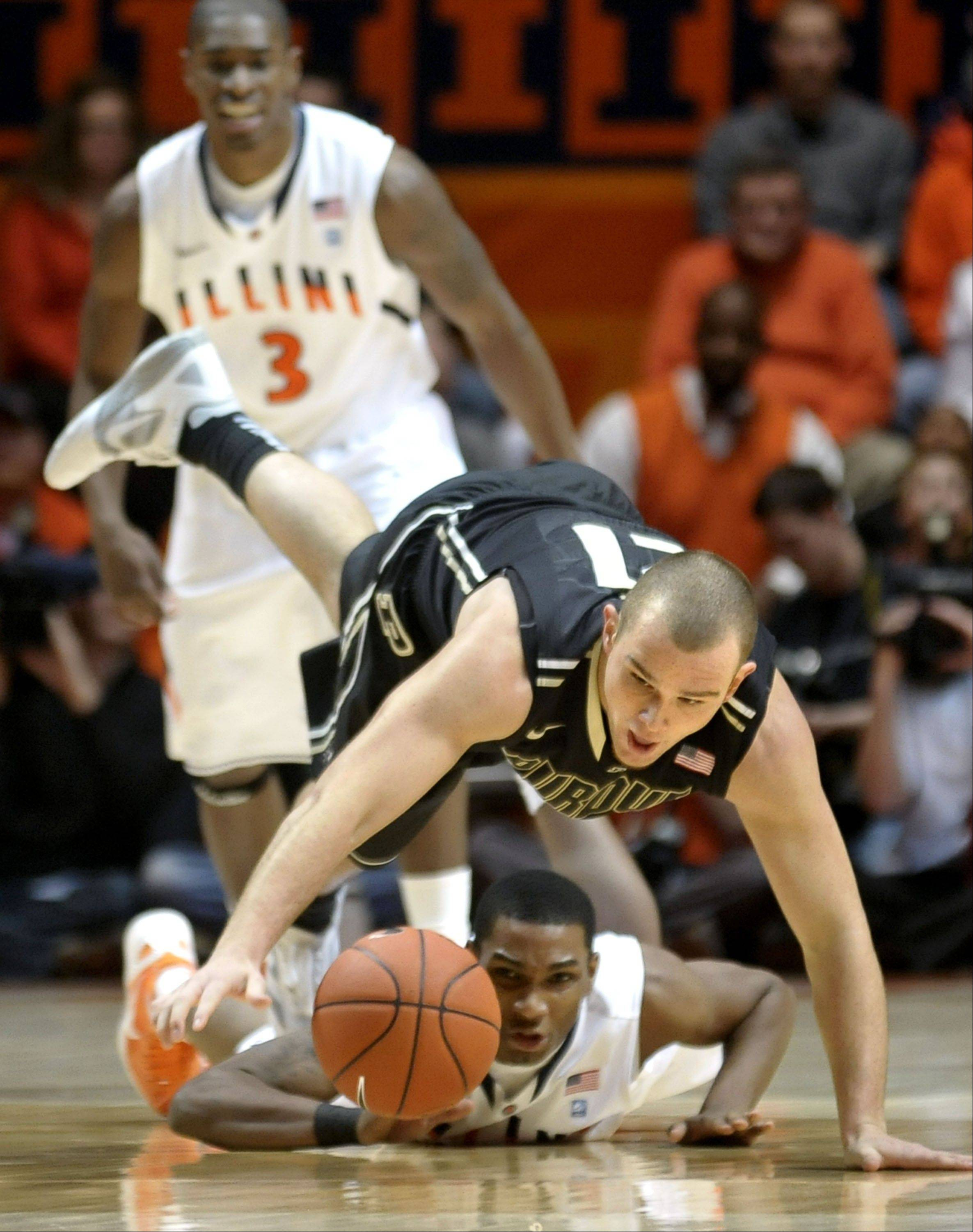 Purdue's D.J. Byrd and Illinois' Tracy Abrams struggle for a loose ball in a Feb. 15 game at Assembly Hall in Champaign last season. Byrd, a 6-foot-5, 228-pound senior, is expected to spend most of his time this season at his more natural swing spot.