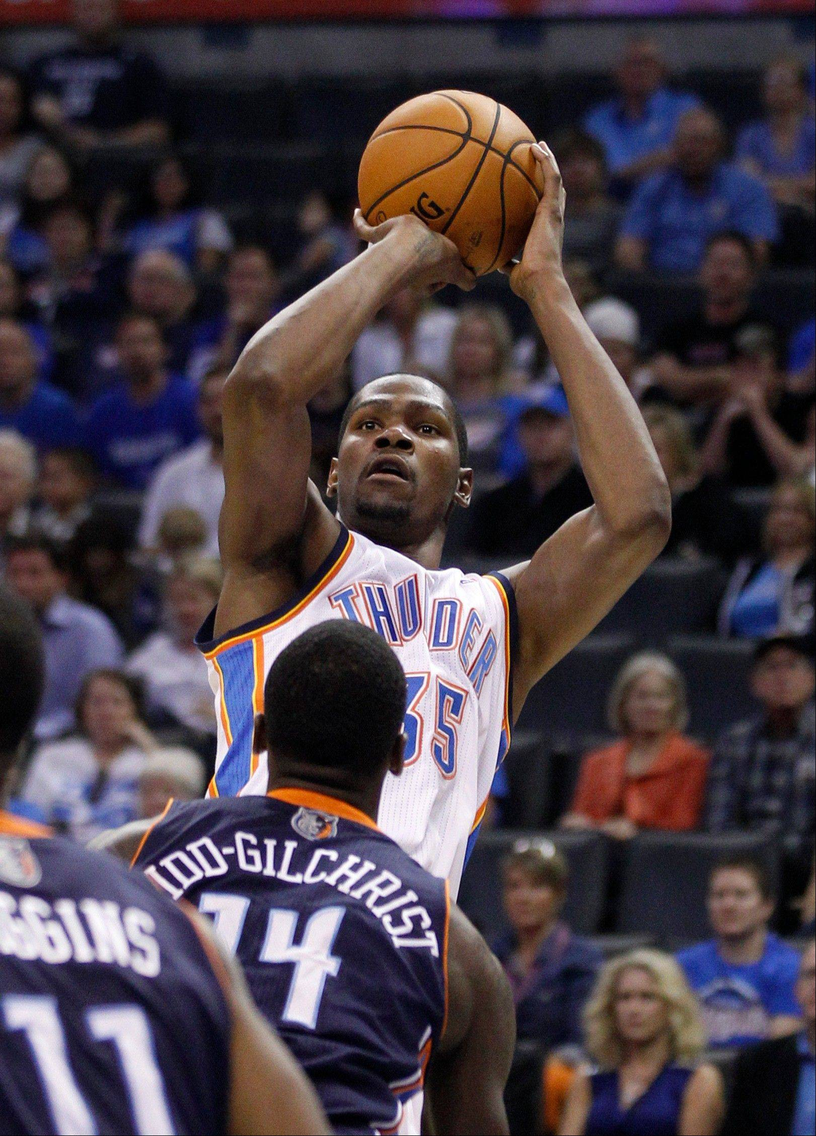 @Caption credited:Associated PressMike McGraw predicts that forward Kevin Durant and the Oklahoma City Thunder will win the Western Conference title this season.