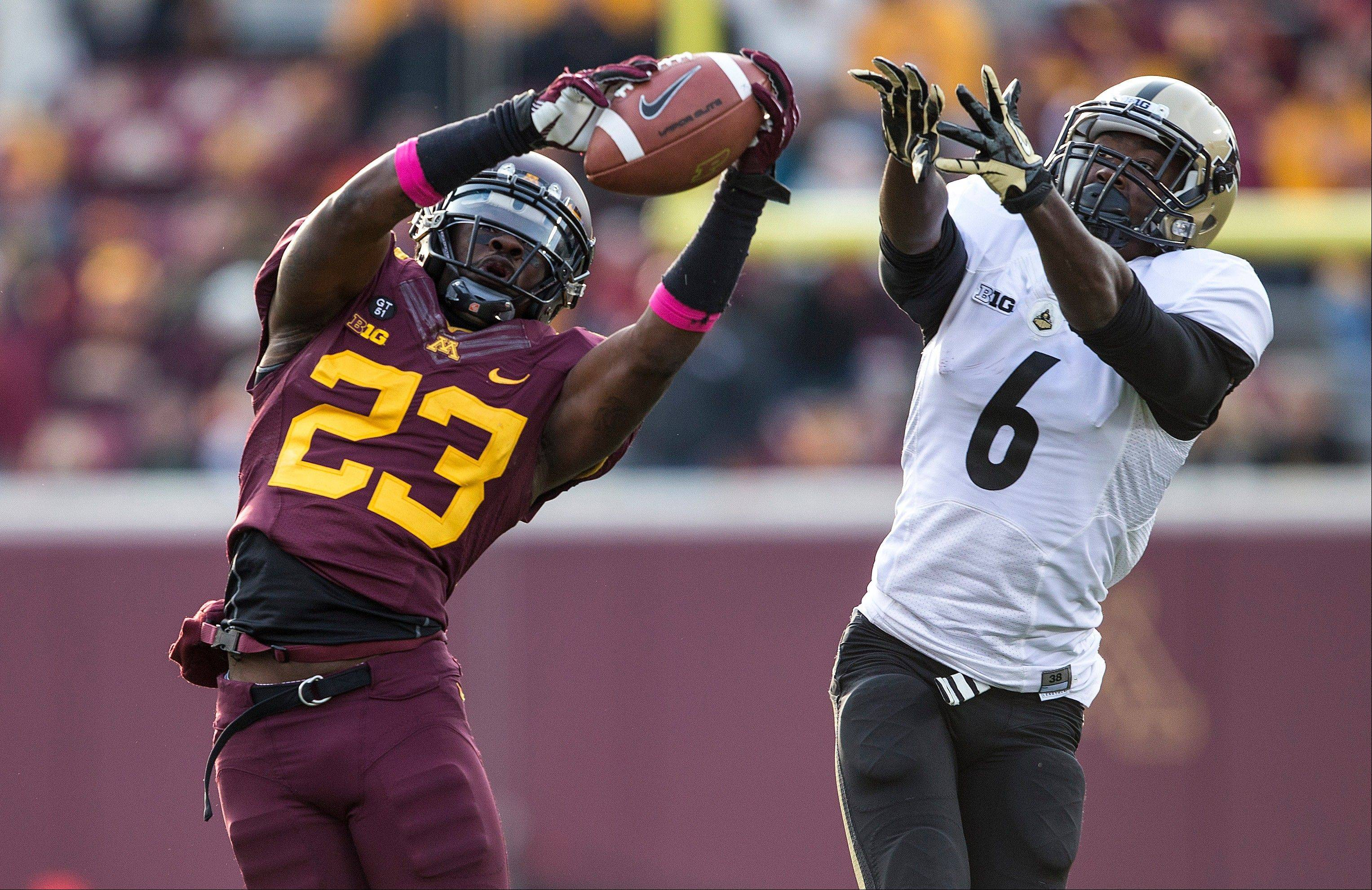 Minnesota defensive back Michael Carter intercepts a pass intended for Purdue wide receiver Gary Bush in the second half of Saturday's game in Minneapolis. Purdue has lost four straight Big Ten games, including Saturday's 44-28 setback at Minnesota.