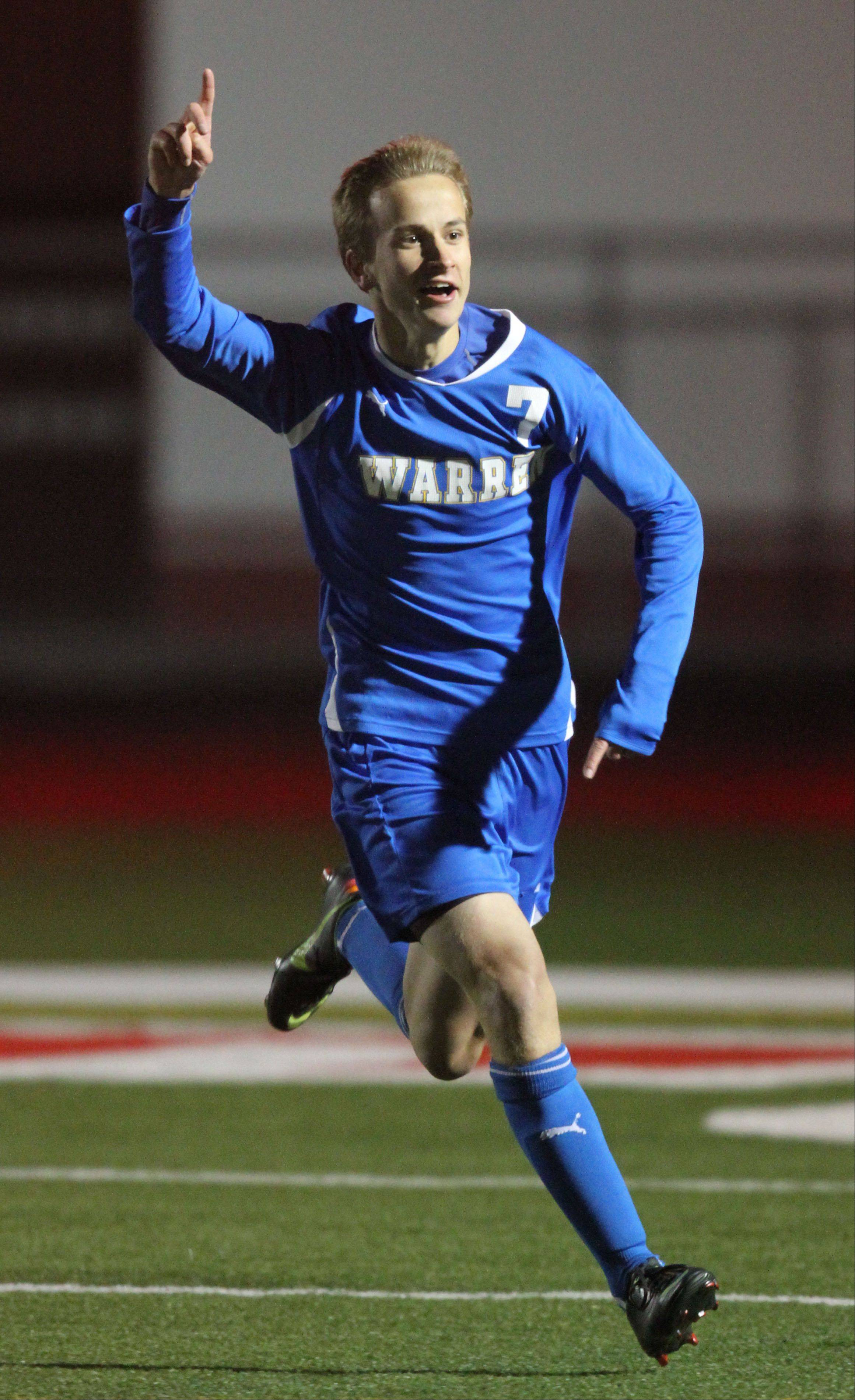 Warren�s Nick Wegrzynowicz celebrates after a goal in the first half during super sectional soccer action Tuesday night at Barrington High School.