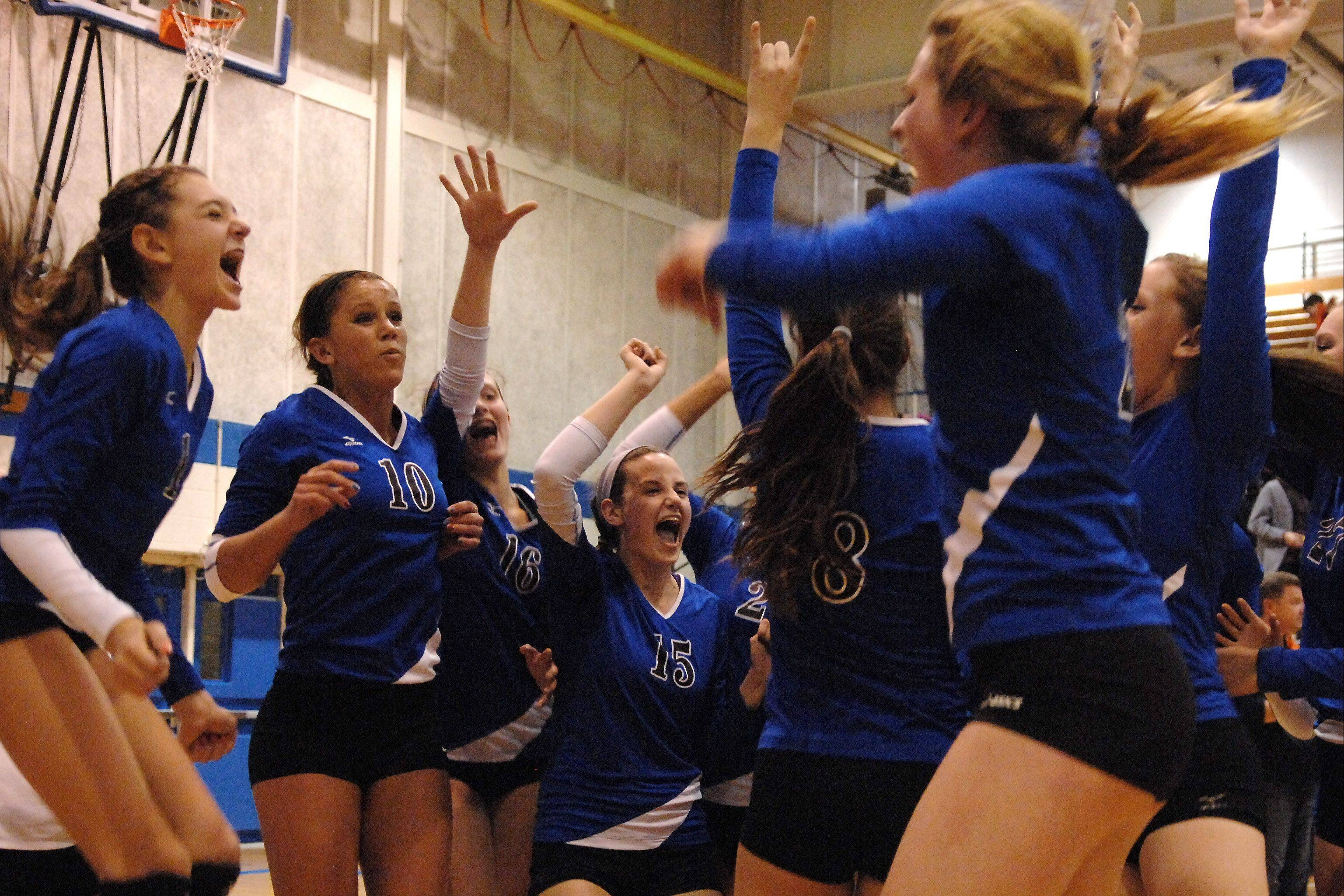 Geneva celebrates its victory over St. Charles East at Tuesday�s sectional semifinals at Larkin.