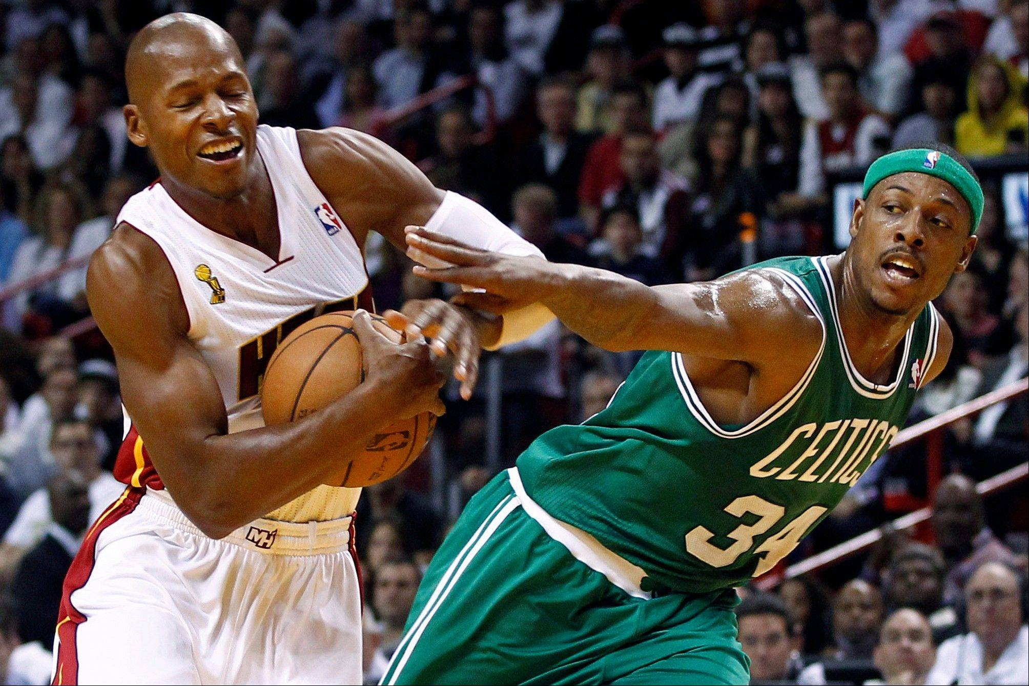 Boston Celtics forward Paul Pierce fouls Miami Heat guard Ray Allen, left, Tuesday during the first half in Miami.
