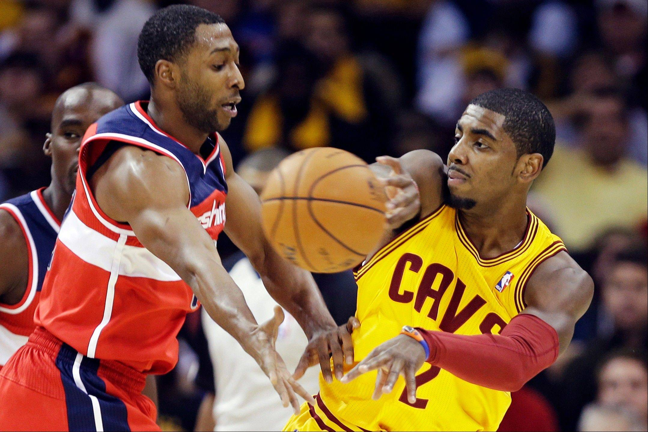 Cleveland Cavaliers guard Kyrie Irving passes away from Washington Wizards' A.J. Price Tuesday during the first quarter in Cleveland.